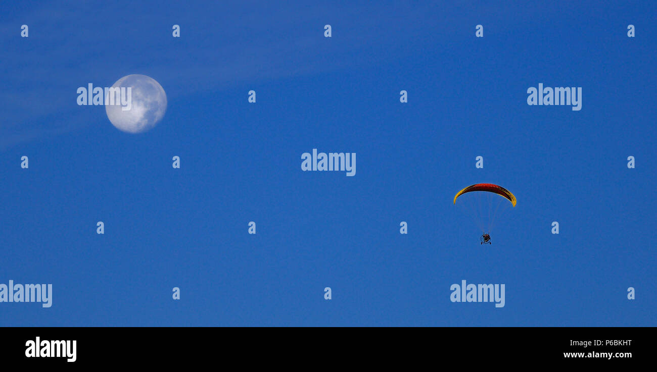 Europe, France, flying a paramotor near the Moon - Stock Image