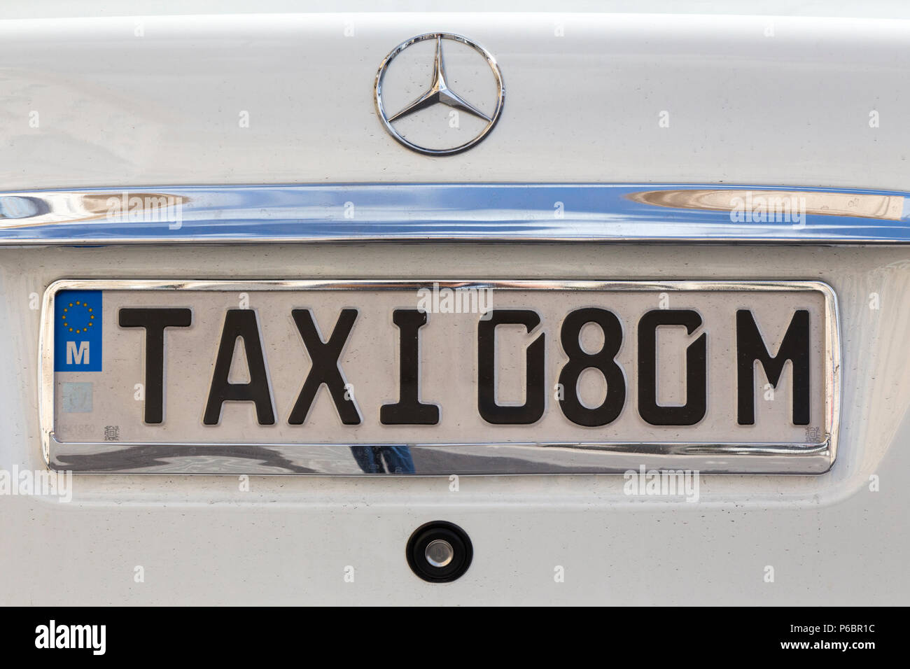 Taxi number plate / registration plate numberplate on a Maltese Mercedes cab working on the streets of Valletta, on the Island of Malta. (91) - Stock Image