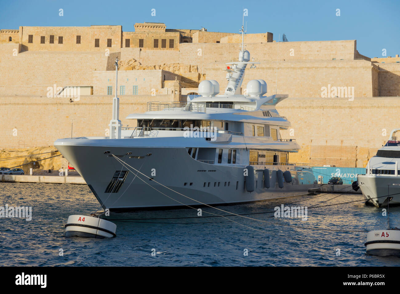 Private yacht 'Plan B': Boats and expensive private super yachts moored at Vittoriosa Yacht Marina shown with the fortifications of Birgu, behind (91) - Stock Image