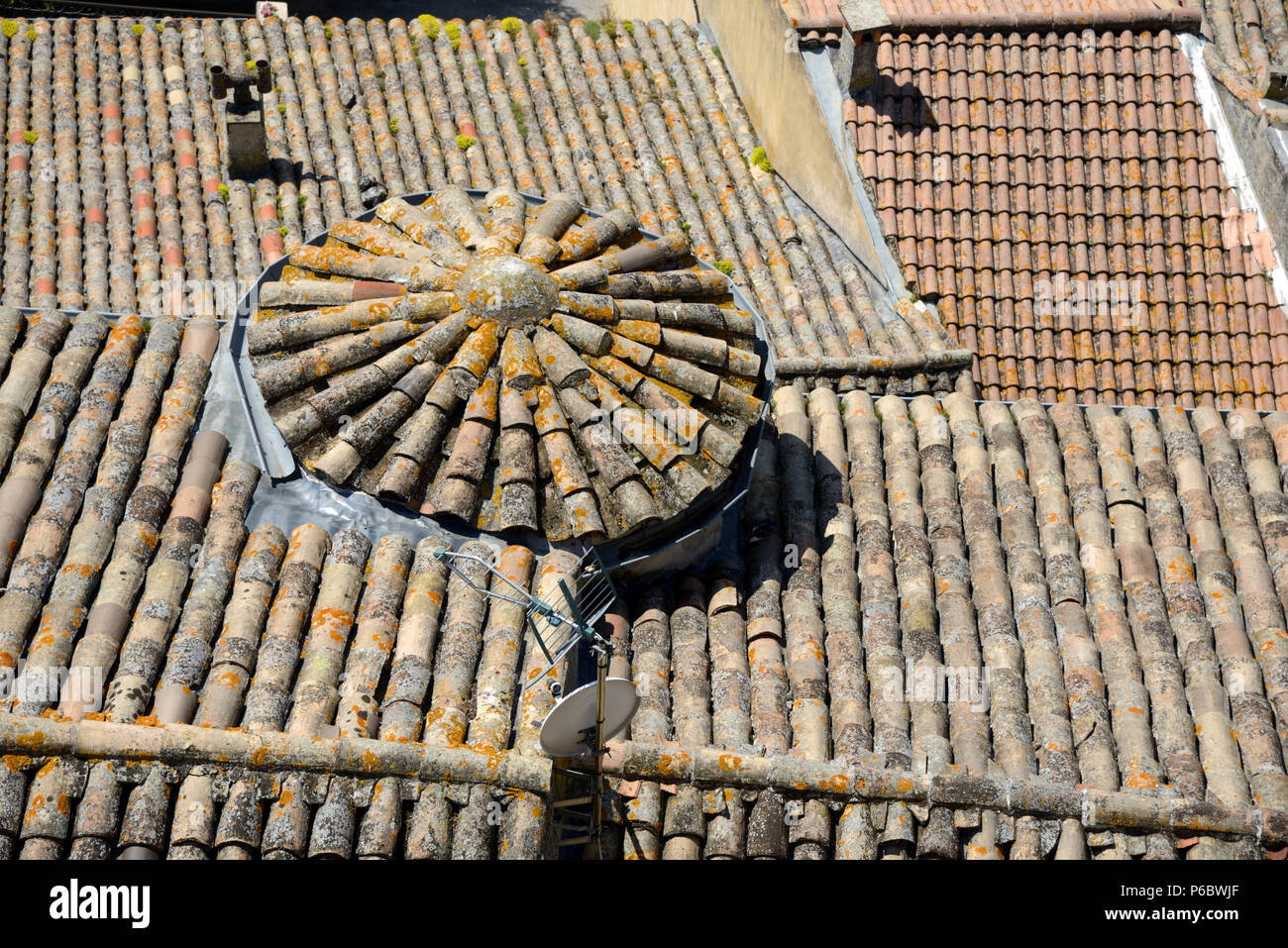 Circular Tiled Roof and View over the Terracotta Tiled Roofs of Grignan Drôme Provence France - Stock Image