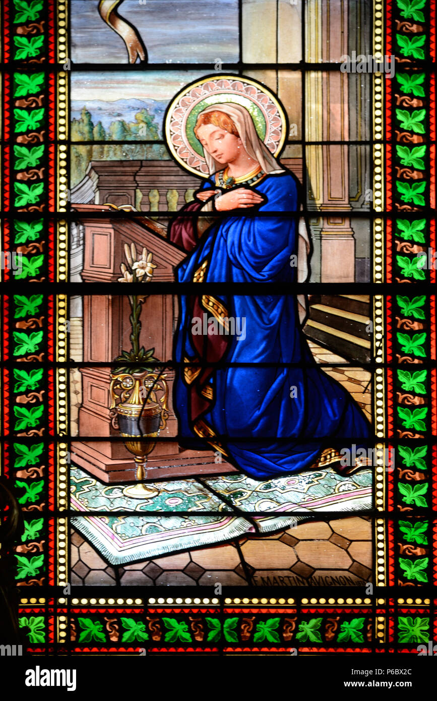 Stained-Glass Window of Saint Praying or Reading the Bible in the Collegiate Church of the Holy Saviour Grignan Drôme France Stock Photo