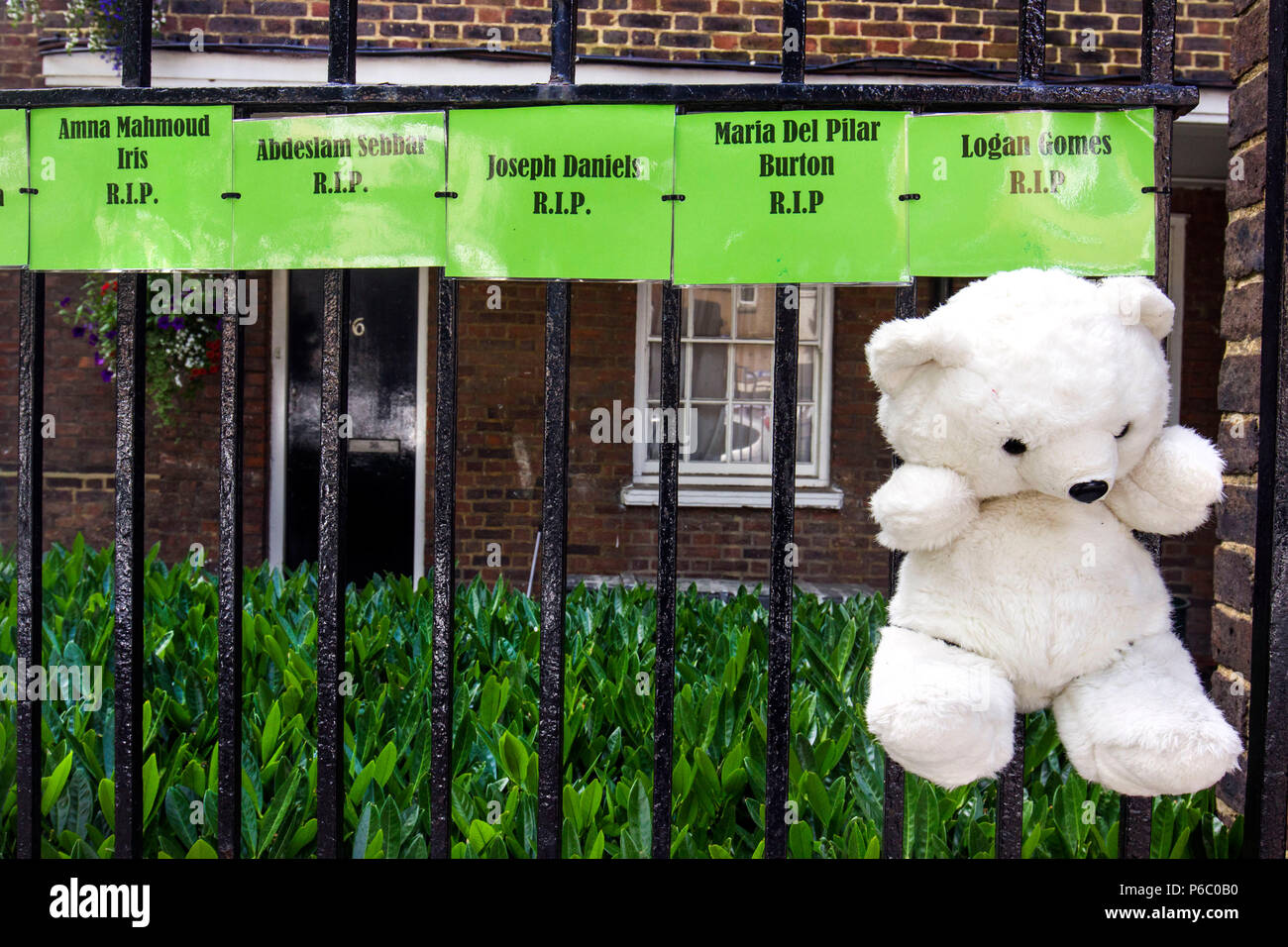 The first anniversary of the 24-storey Grenfell Tower block of public housing flats fire which claimed 72 lives. Banners and signs can be found in the surrounding area acting as memorials and questioning why this happened,  South Kensington, London, UK, 14th June 2018. - Stock Image