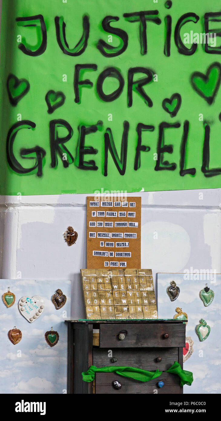 The first anniversary of the 24-storey Grenfell Tower block of public housing flats fire which claimed 72 lives. Justice for Grenfell sign near a makeshift memorial under the Westway flyover.  South Kensington, London, UK, 14th June 2018. - Stock Image