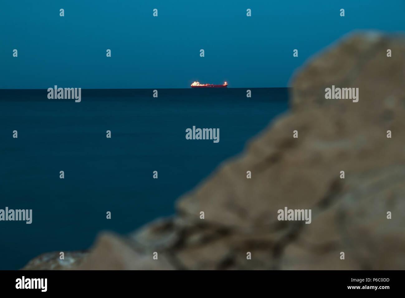 A tanker in the night scene - Stock Image