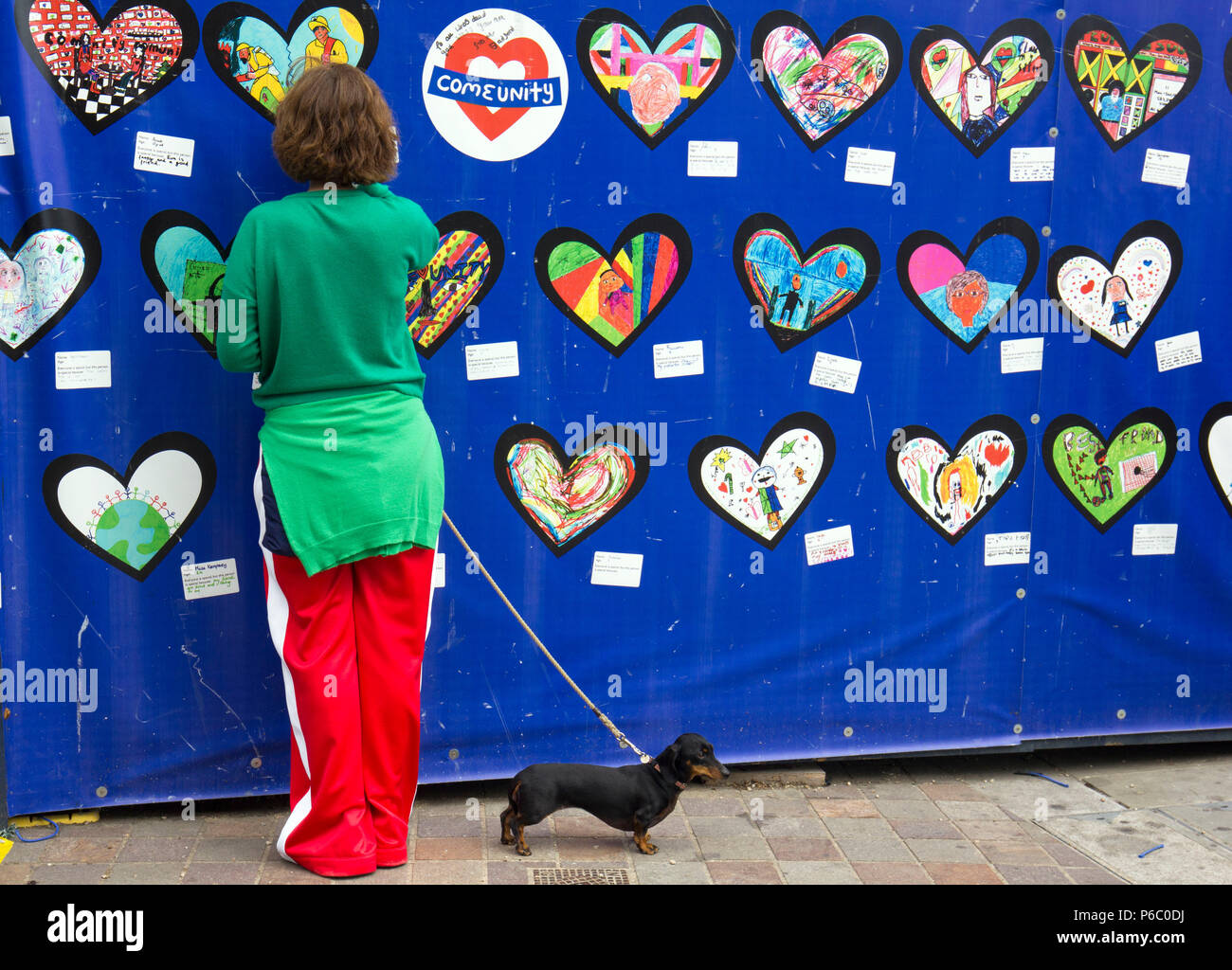 The first anniversary of the Grenfell Tower fire which claimed 72 lives. Memorial wall, South Kensington, London, UK, 14th June 2018. - Stock Image