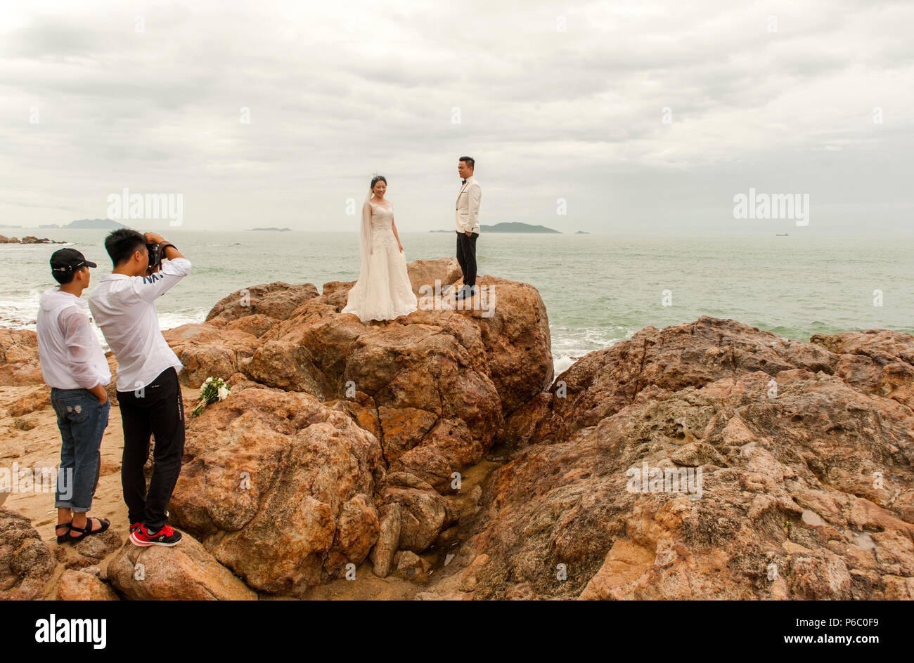The granite rocks of Tianya Haijiao are a popular location for wedding pictures at Sanya, Hainan Dao, China - Stock Image