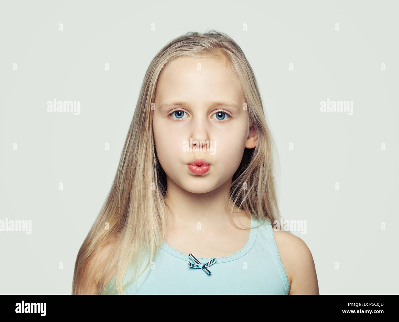 Funny face. Child girl grimacing - Stock Image