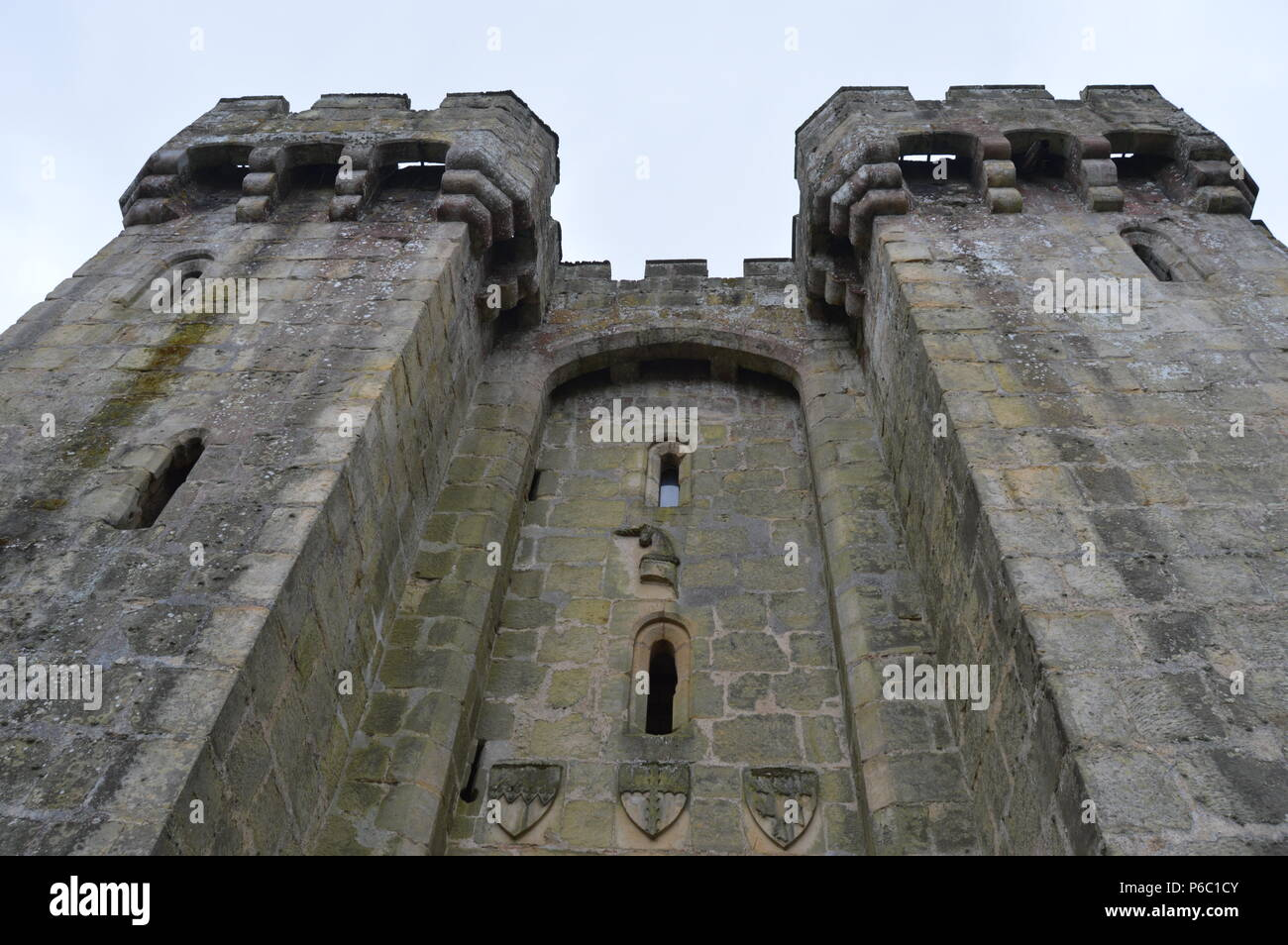 Low angle shot of a British castle's battlements from outside - Stock Image