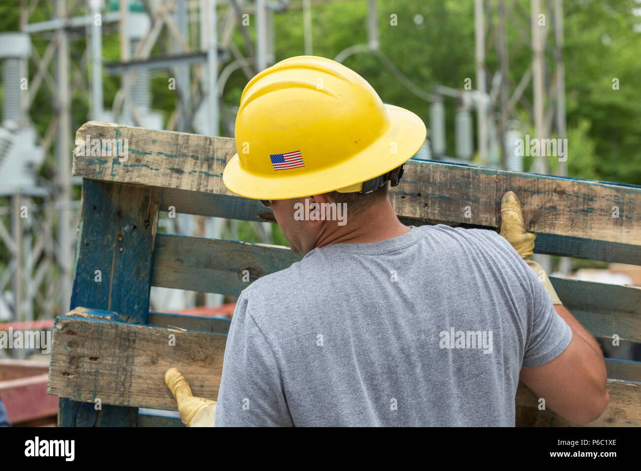 Engineer moving pallet - Stock Image
