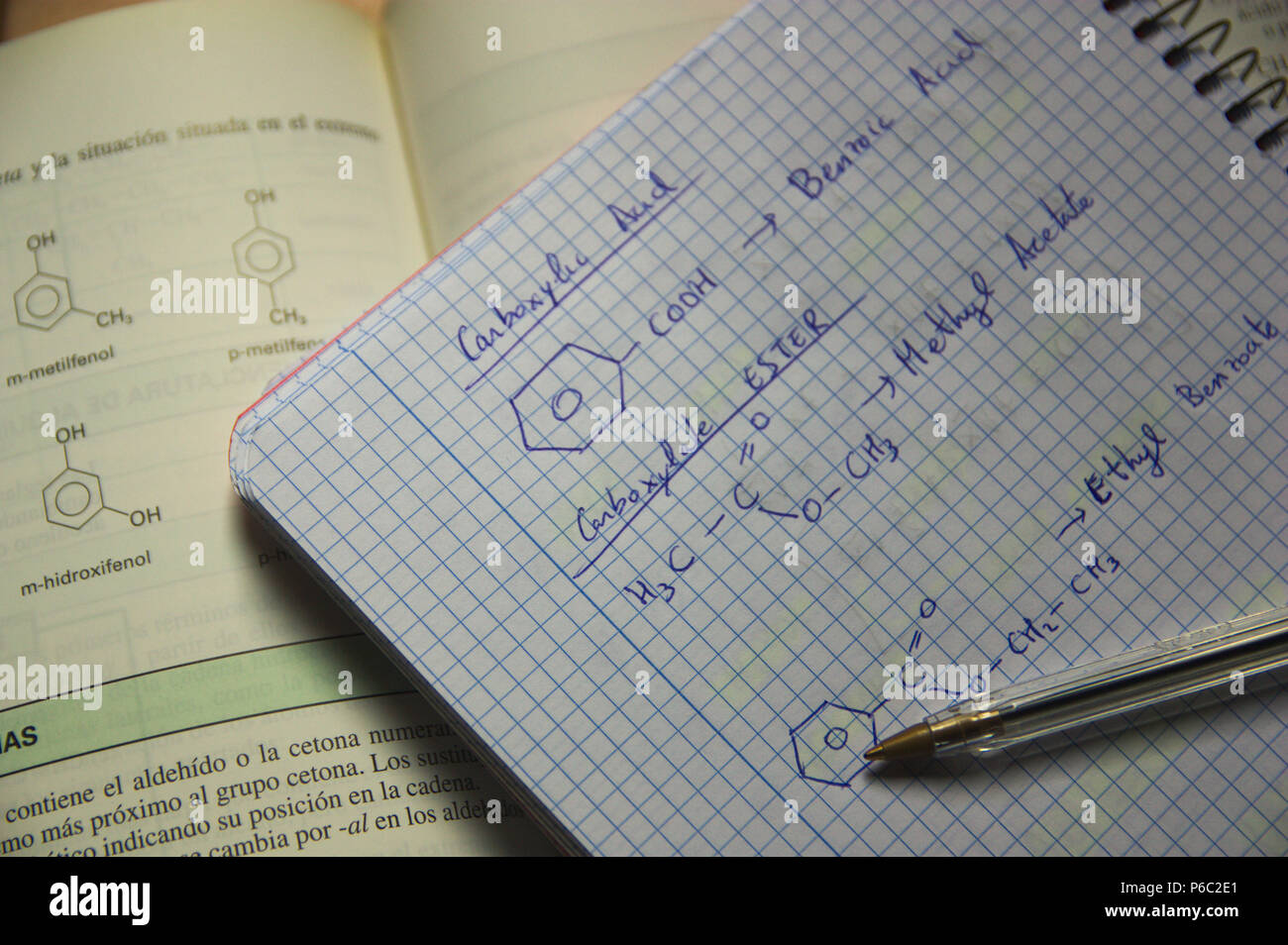 formulas of organic chemistry in a student's class notebook. Stock Photo
