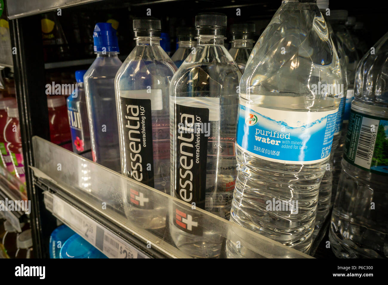 Bottles of Essentia and other waters in a cooler in a convenience store in New York on Thursday, June 14, 2018. Essentia, one of players in the functional water space, has hired Credit Suisse to run an auction of the company hoping to attract a larger beverage brand such as PepsiCo or Nestle. Essentia claims superior hydration due to a proprietary method of ionizing the water. (© Richard B. Levine) - Stock Image