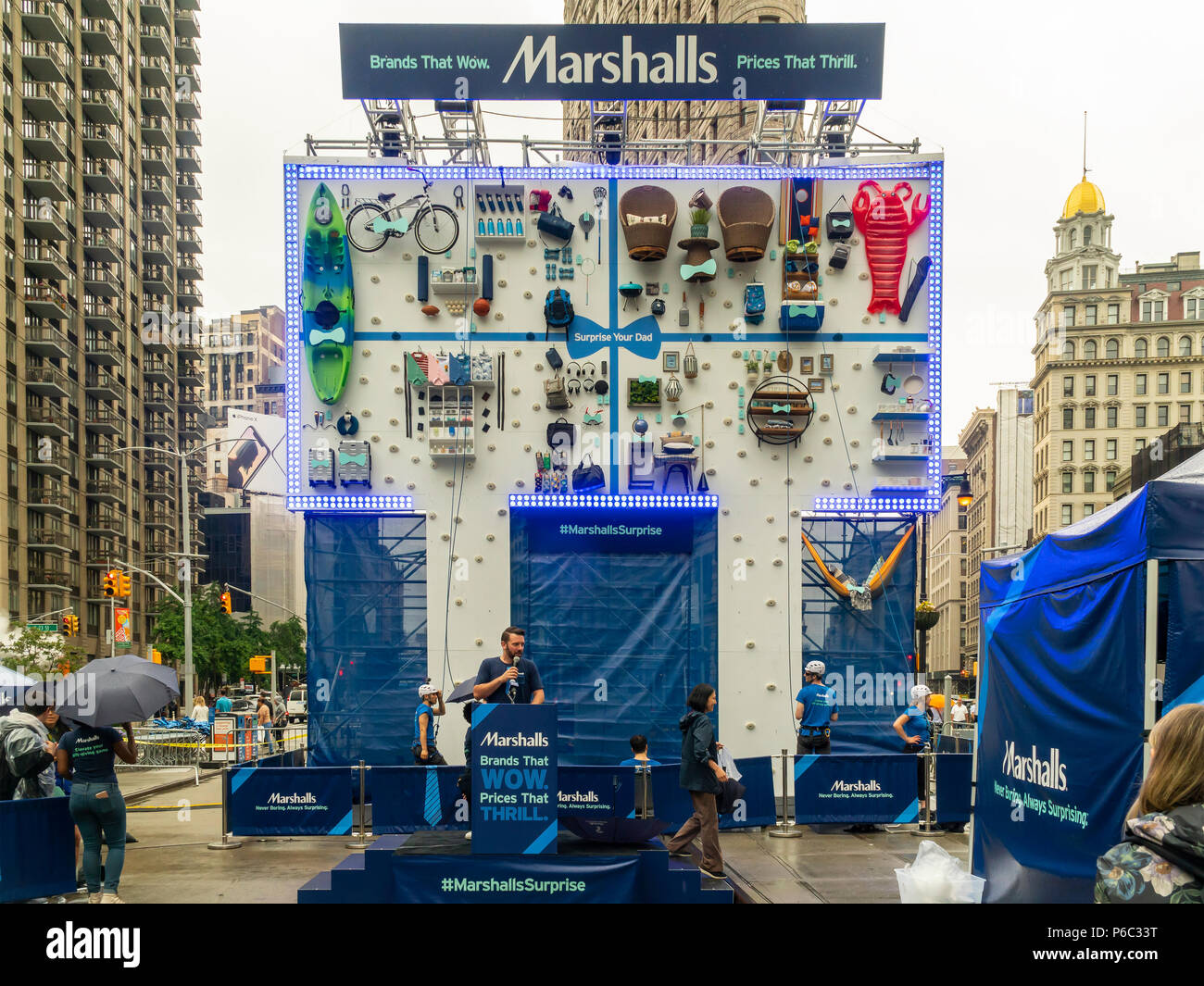 fd2931decb51 Climbers retrieve prizes for participants in a Marshalls branding event in  Flatiron Plaza in New York