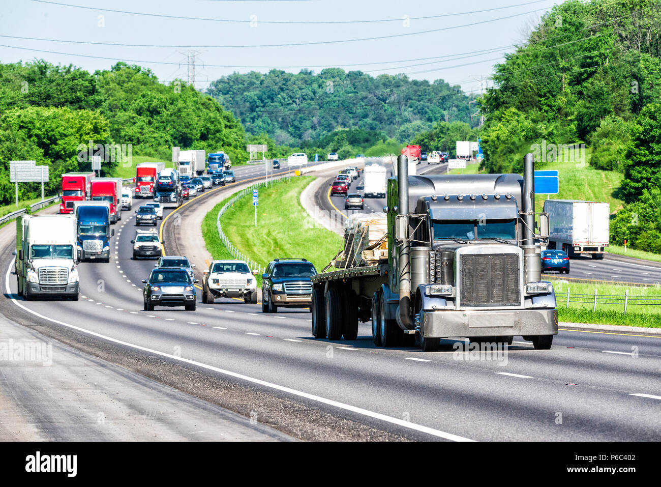 An interstate highway in eastern Tennessee bears a heavy load of traffic. Note: All logos and identifying marks have been removed from all vehicles.   - Stock Image