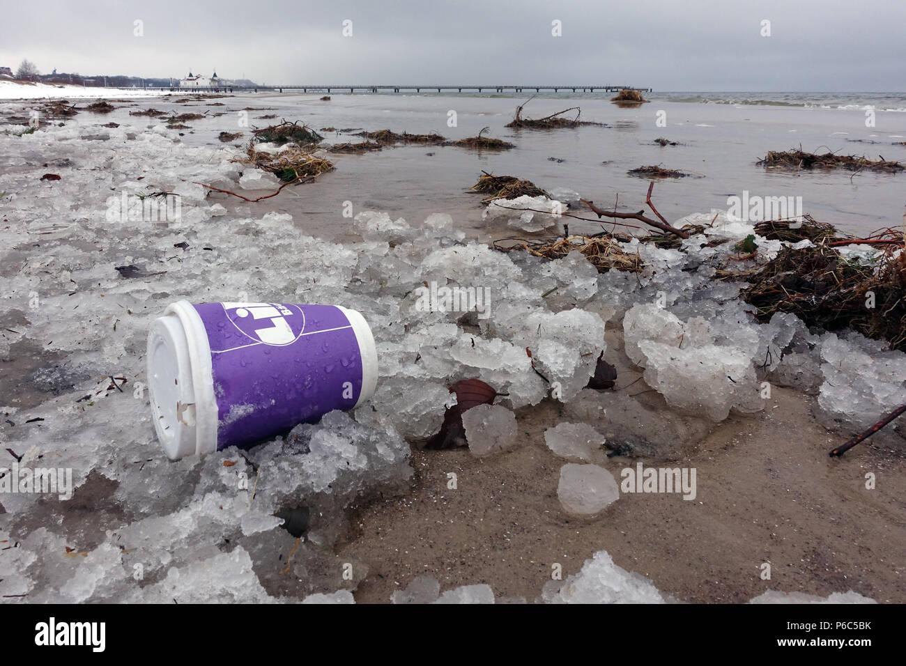 Ahlbeck, Germany, Empty coffee mug lying on the beach in the ice Stock Photo
