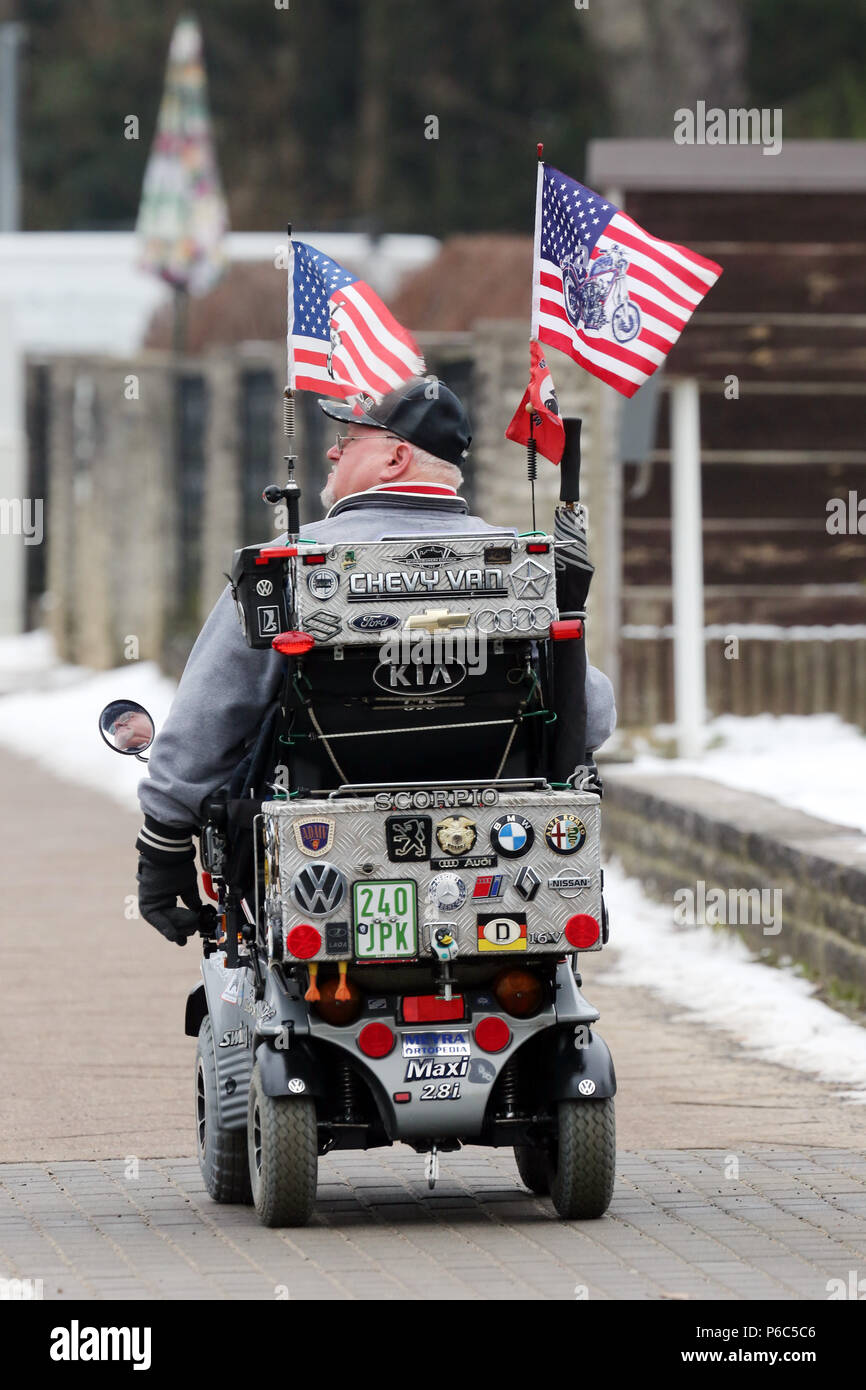 Neuenhagen, man drives his US-flagged electric wheelchair on the day of the swearing-in of US President Donald Trump - Stock Image