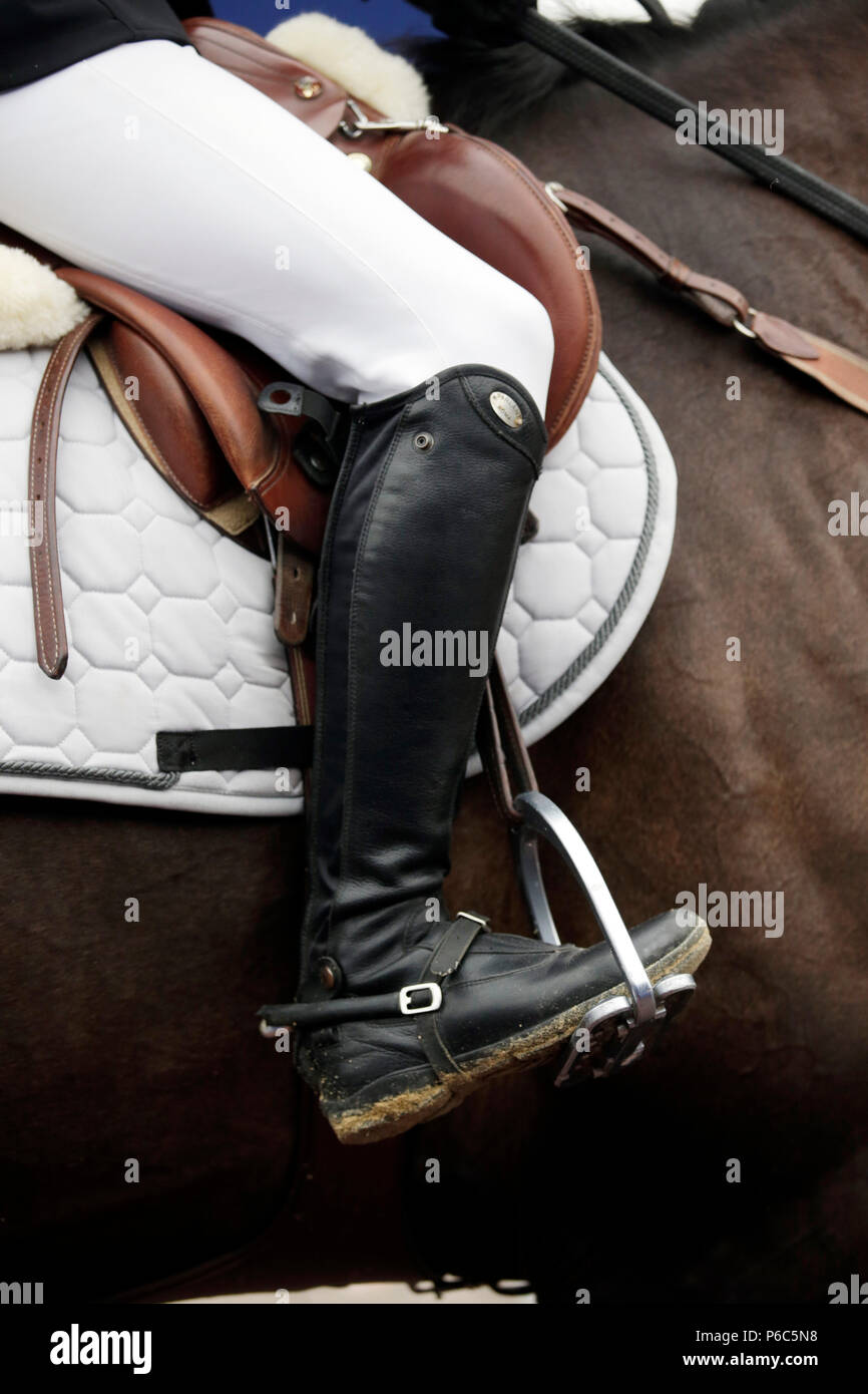 Doha, riding boots with spur in a stirrup - Stock Image