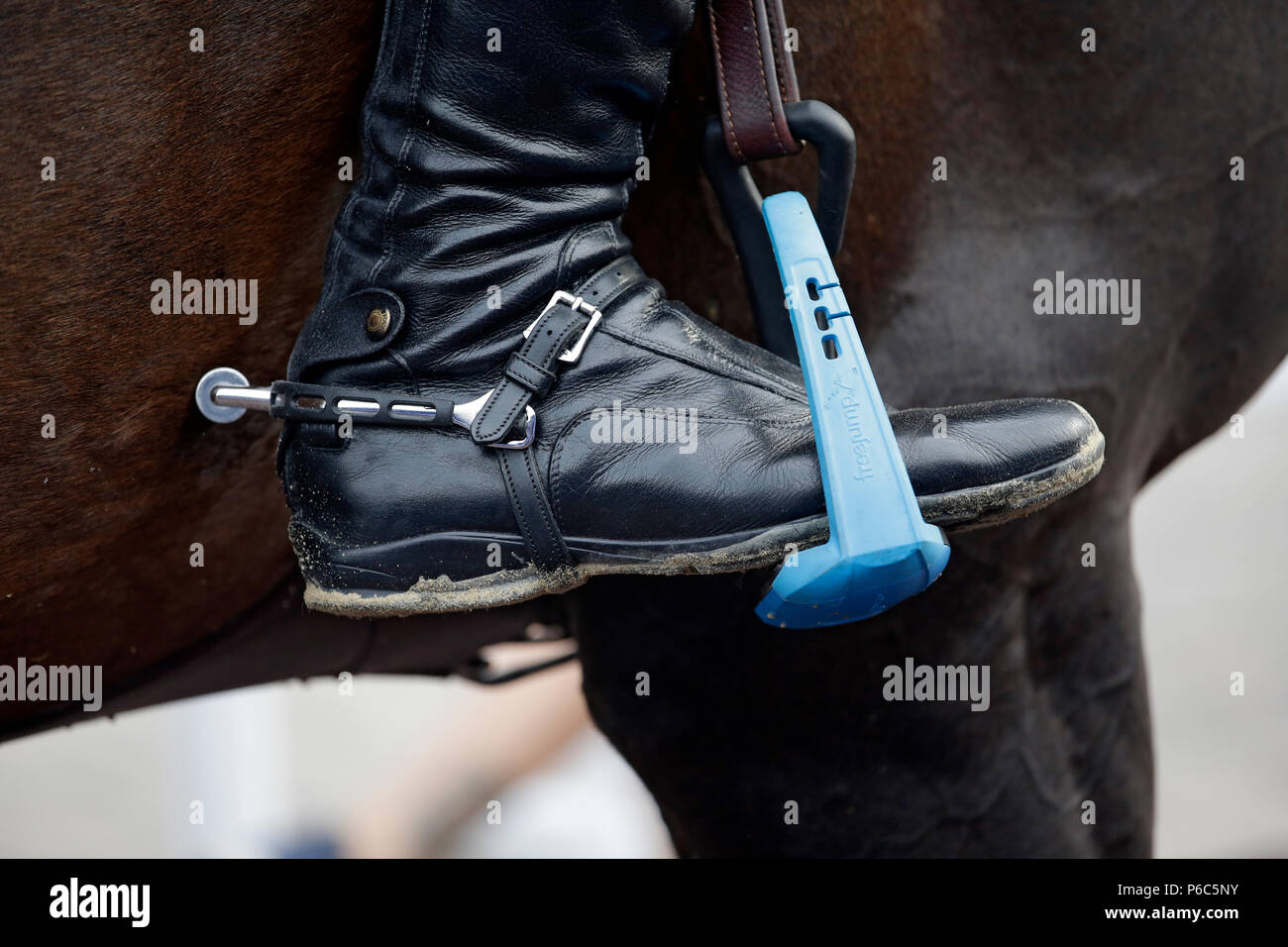 Doha, riding boots with spur in a safety platform - Stock Image