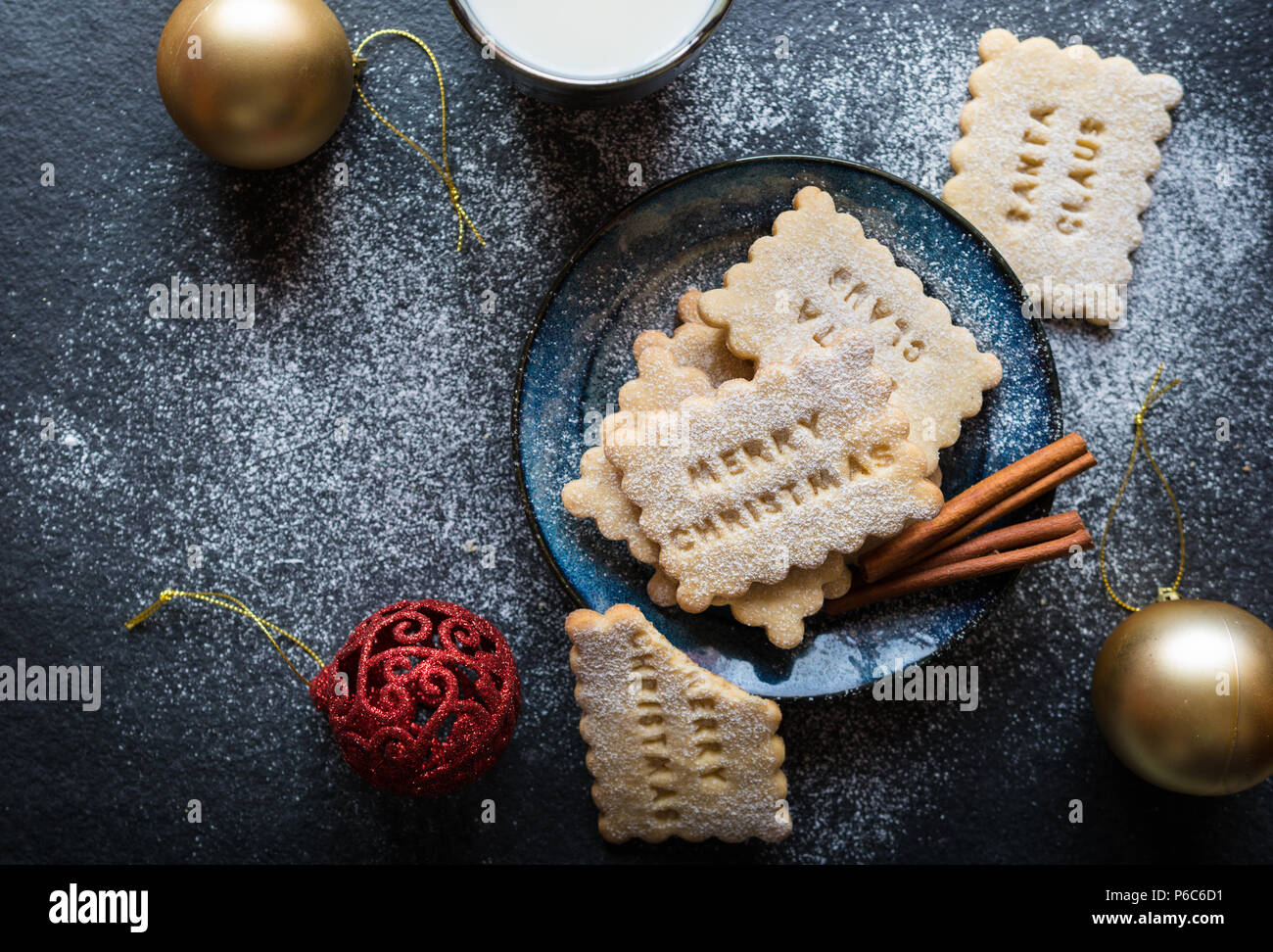 Homemade honey and cinnamon biscuits decorated with Christmas stamps Stock Photo