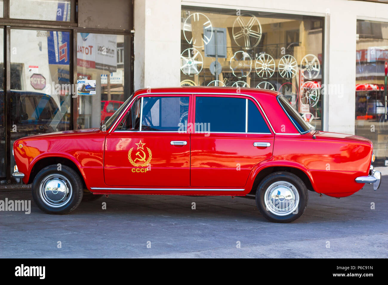 Red Car Zhiguli With Symbol Hammer And Sickle And Inscription Ussr