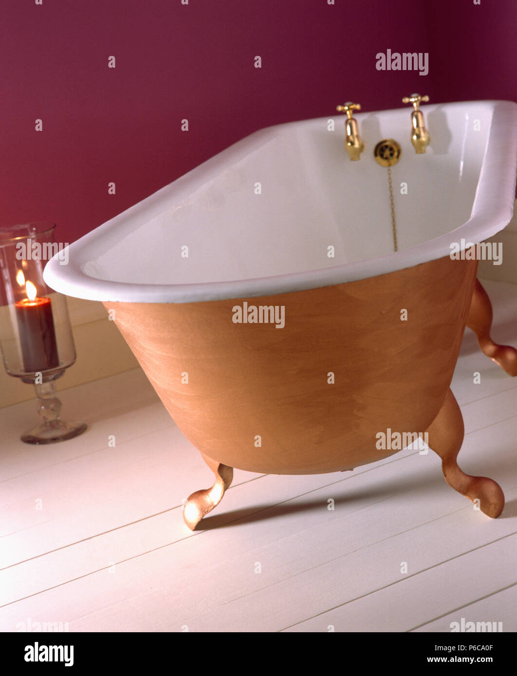 Close-up of claw-foot bath with brass taps Stock Photo: 210483631 ...
