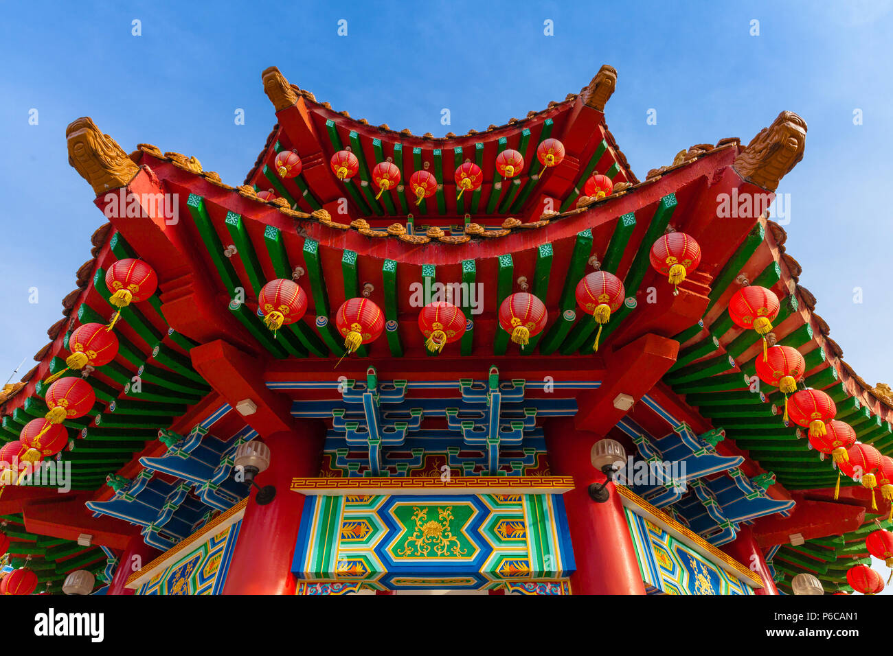 The roof of the Thean Hou Temple decorated with red Chinese lanterns, Kuala Lumpur, Malaysia - Stock Image