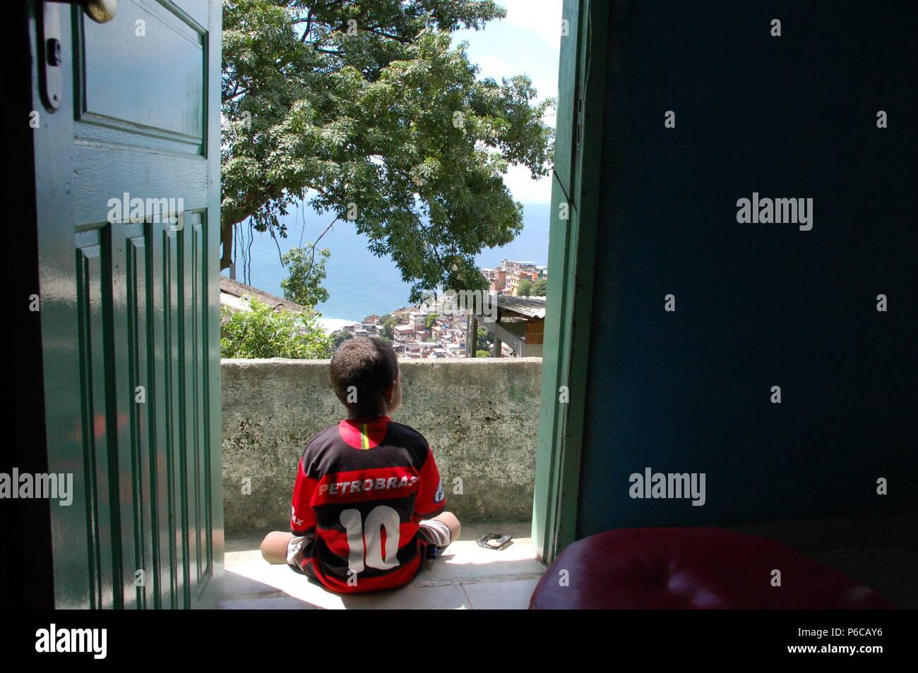 A football boy in the favela, Vidigal, Rio de Janeiro - Stock Image