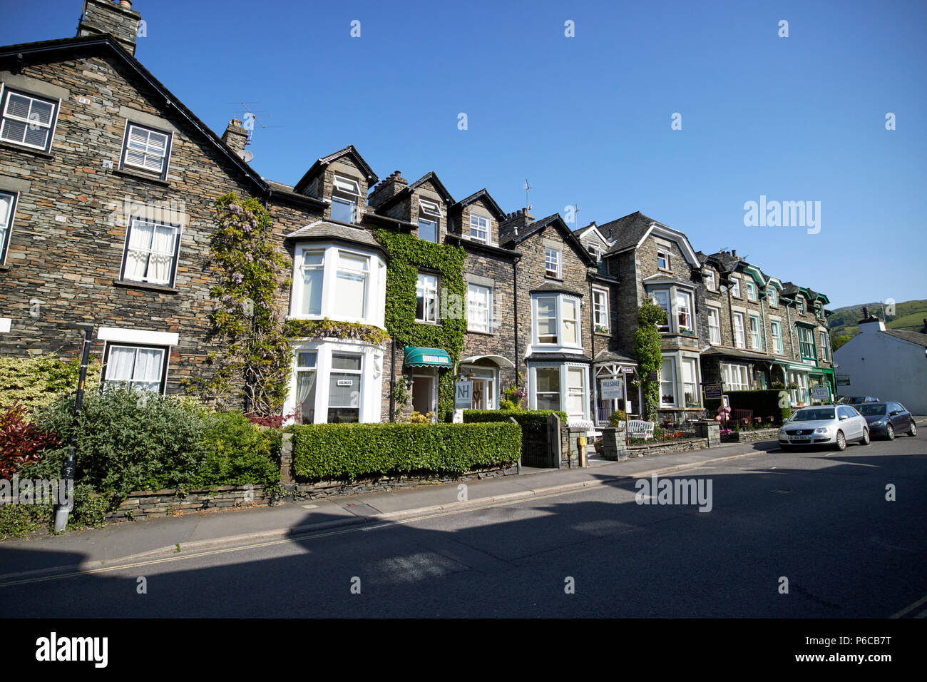 Traditional lakeland stone houses now mostly b+b in Ambleside lake district cumbria england uk - Stock Image
