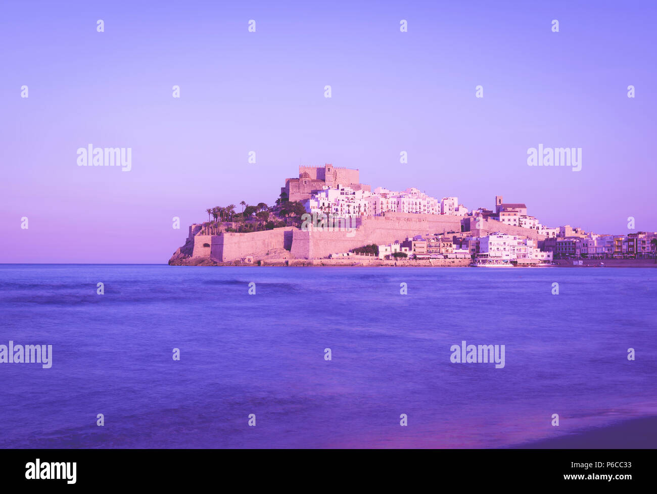 Castle of Peniscola, located on Costa del Azahar in the Castellon province of Spain, ultraviolet color style - Stock Image