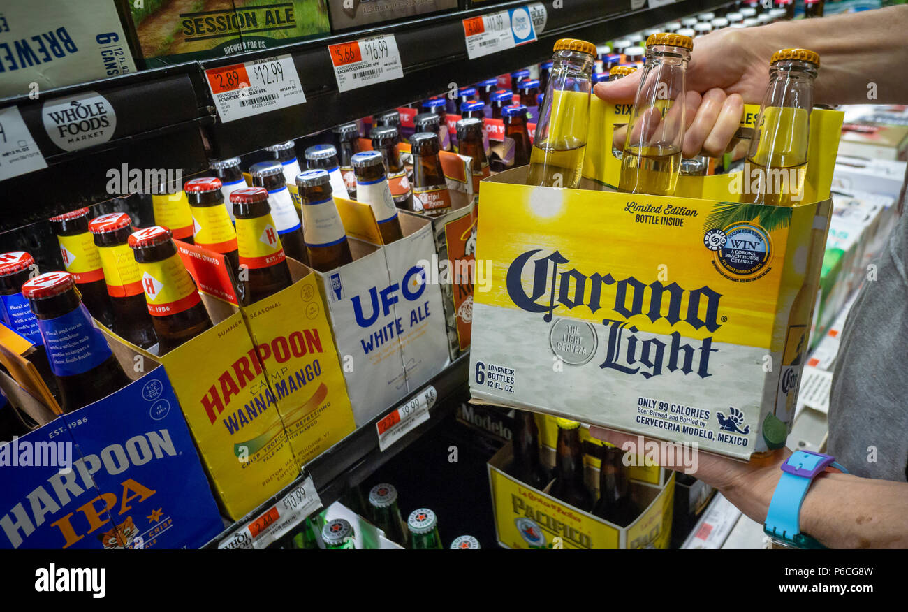 A shopper chooses a six-pack of Constellation Brands' Corona Light beer in a supermarket in New York on Thursday, June 28, 2018. Constellation Brands is scheduled to reort earnings on Friday, June 29, 2018 prior to the bell. (© Richard B. Levine) - Stock Image