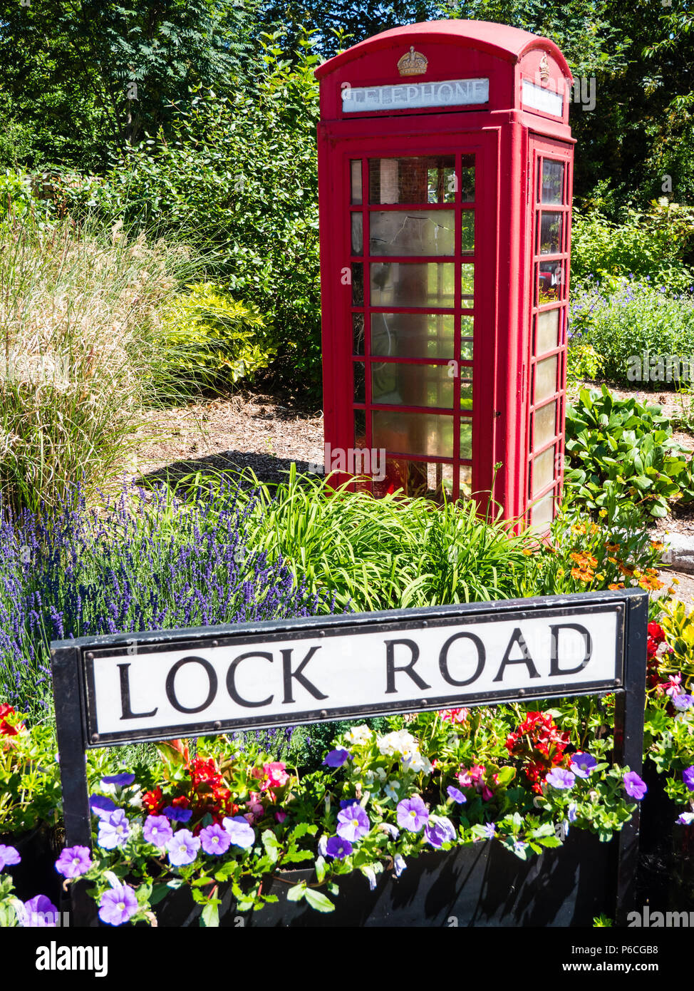 Lock Road Sign, with Flowers, and Red Telephone Box, Marlow, Buckinghamshire, England, UK, GB. - Stock Image