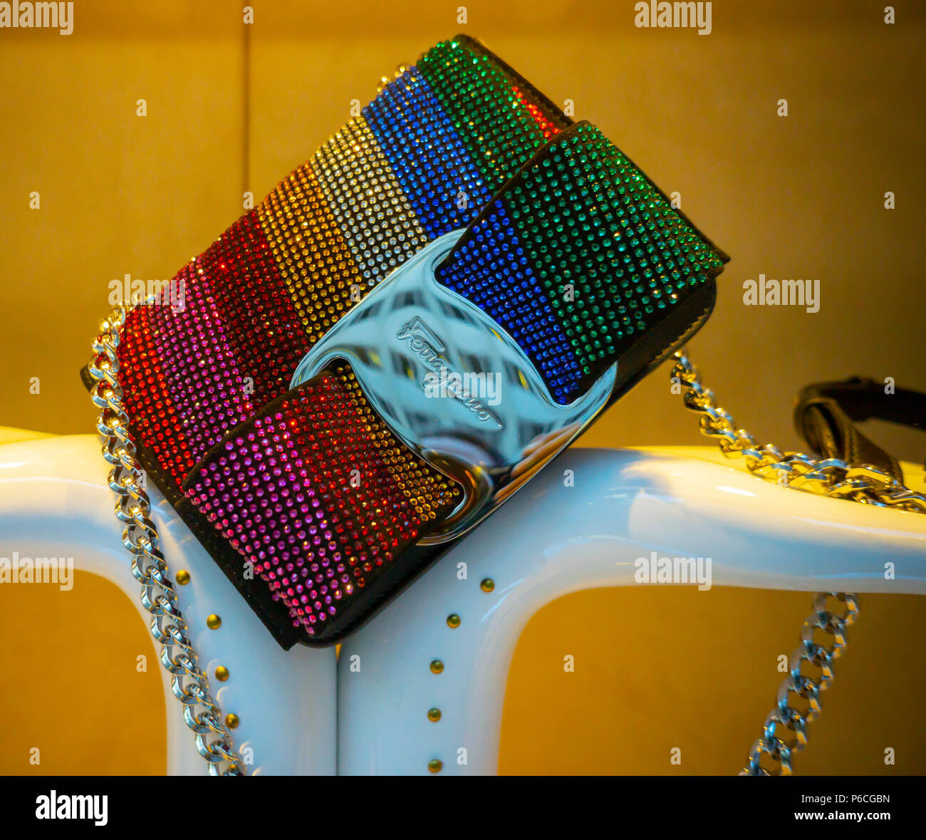 A rainbow pride themed handbag in the window of the Salvatore Ferragamo store on Fifth Avenue in New York on Tuesday, June 19, 2018. Ferragamo Finanziaria has sold a 3.5 percent stake in the company although the family still controls 65 percent of the stock. (© Richard B. Levine) - Stock Image