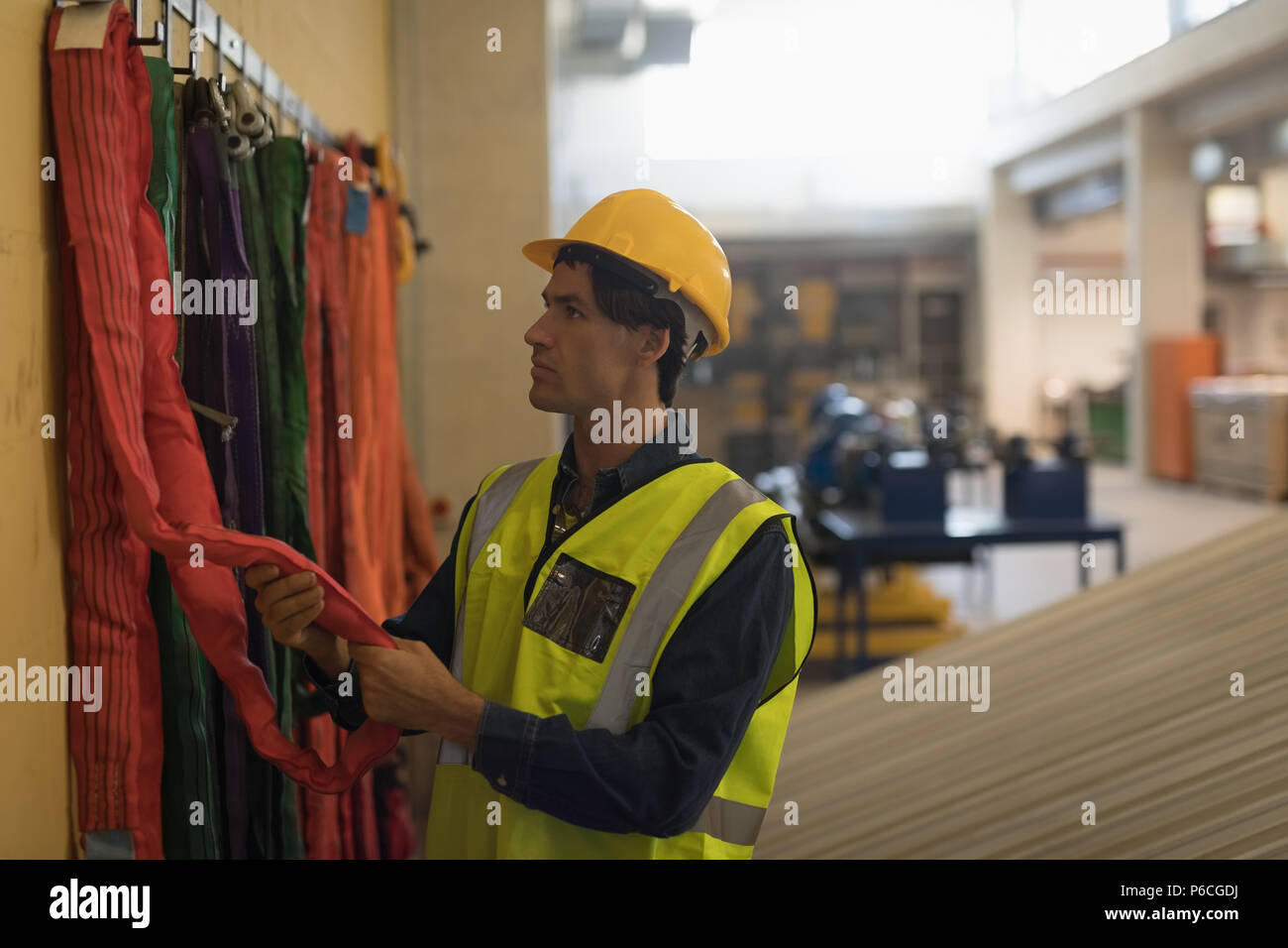 Male worker working at solar station - Stock Image