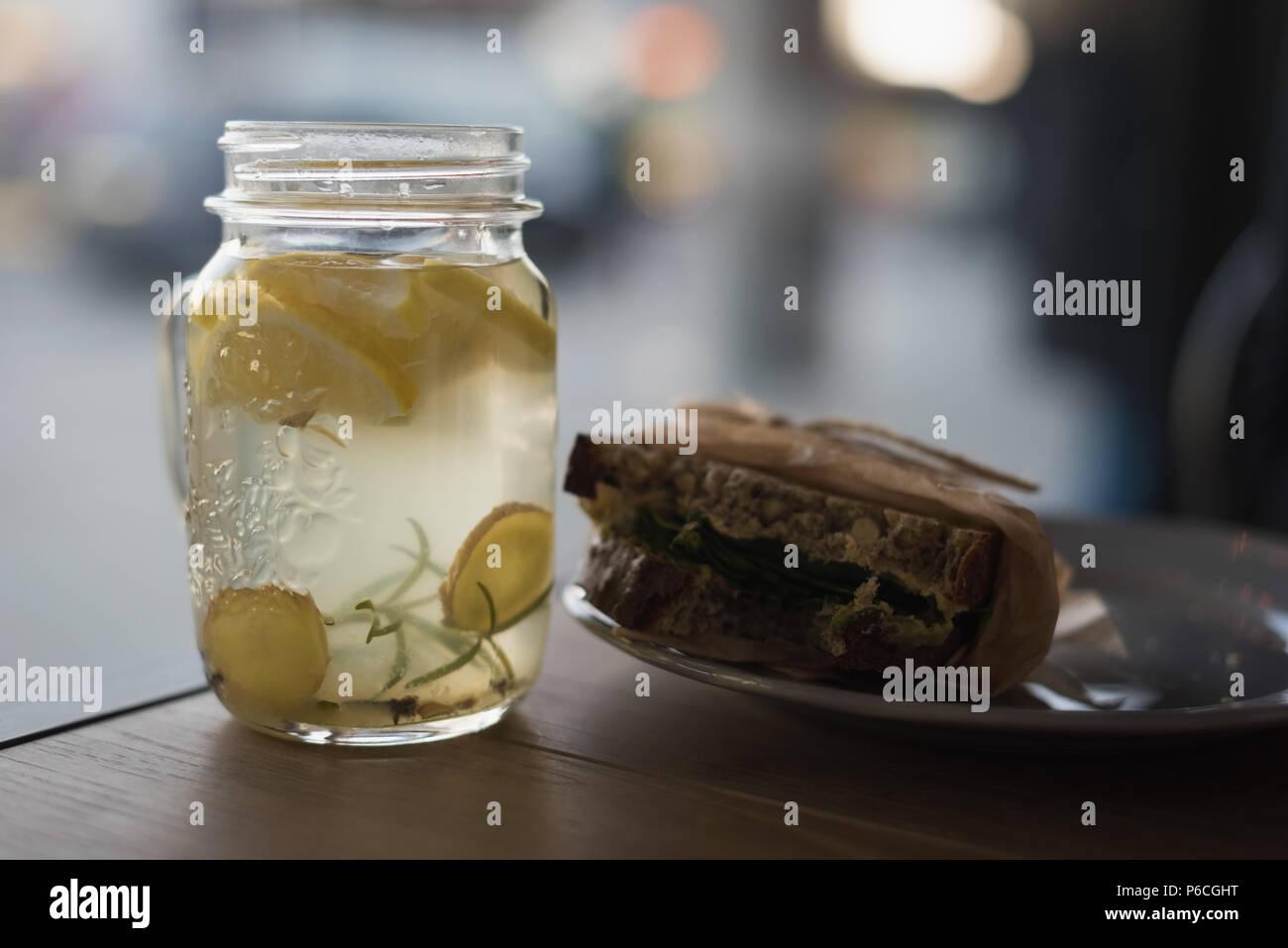 Jar of lemon tea with wrap food on plate Stock Photo