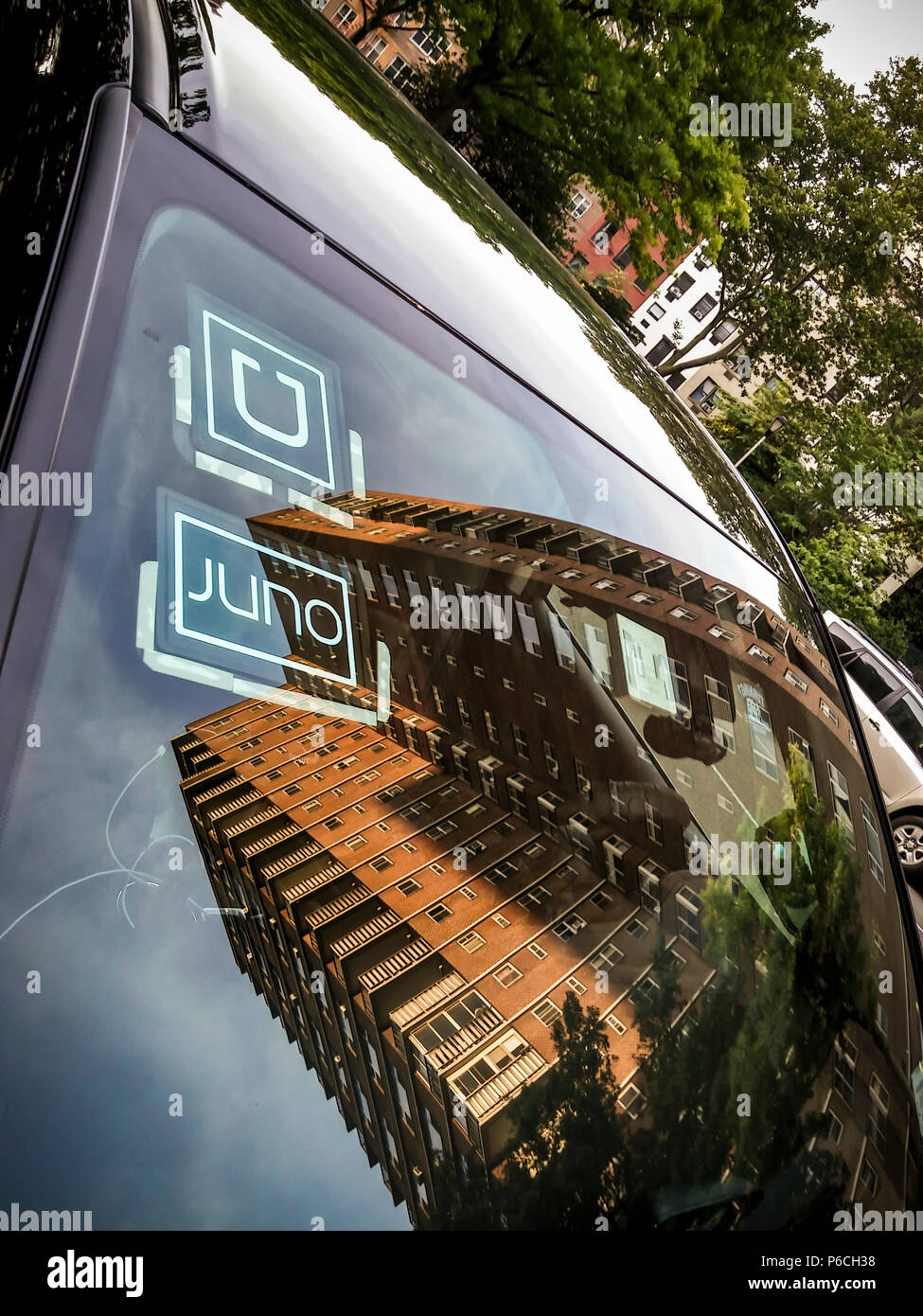 A livery with affiliation stickers for both competing Juno and Uber ride-sharing services in New York on Tuesday, June 26, 2018.(© Richard B. Levine) - Stock Image
