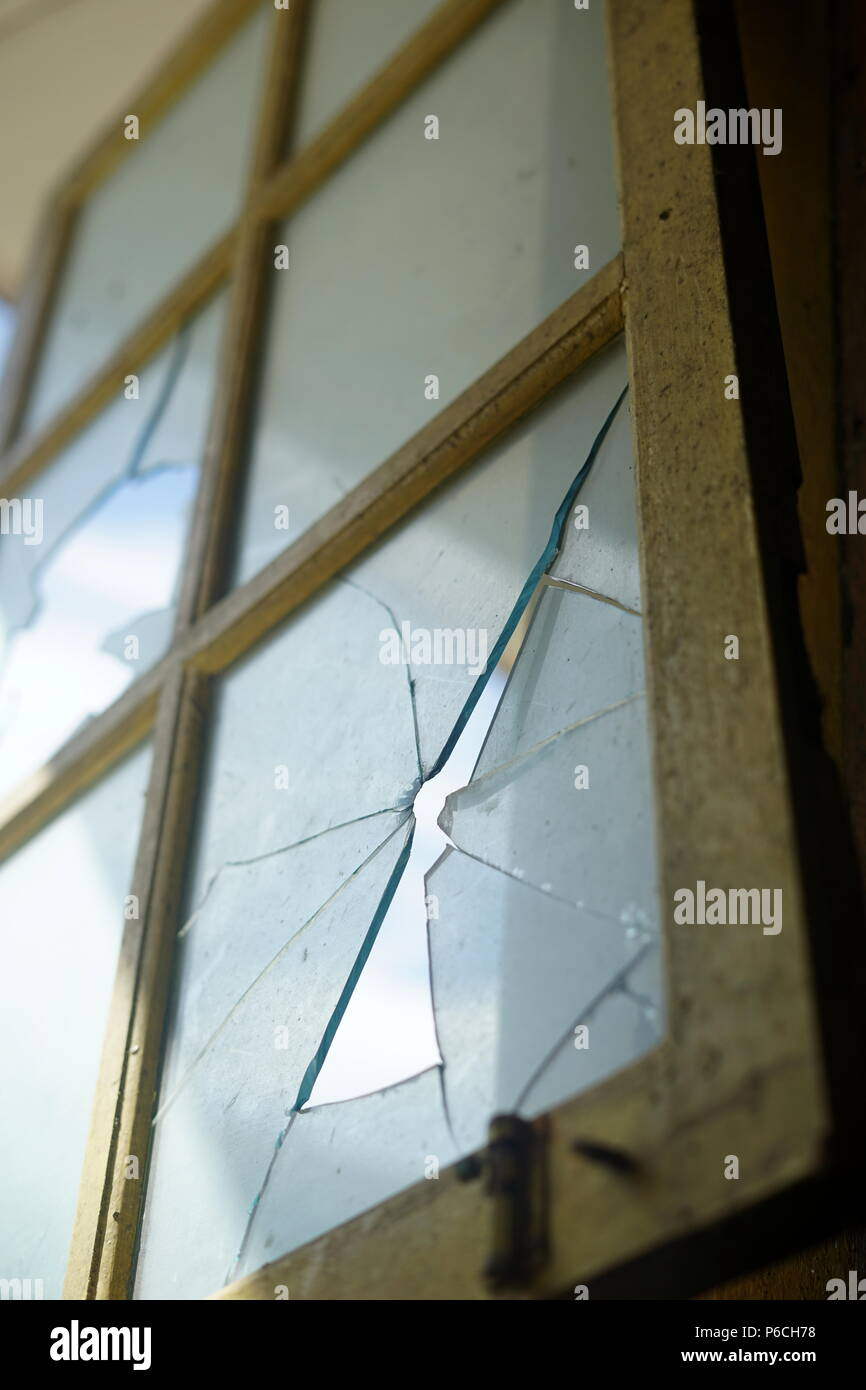 Bullet hole in the window - Stock Image