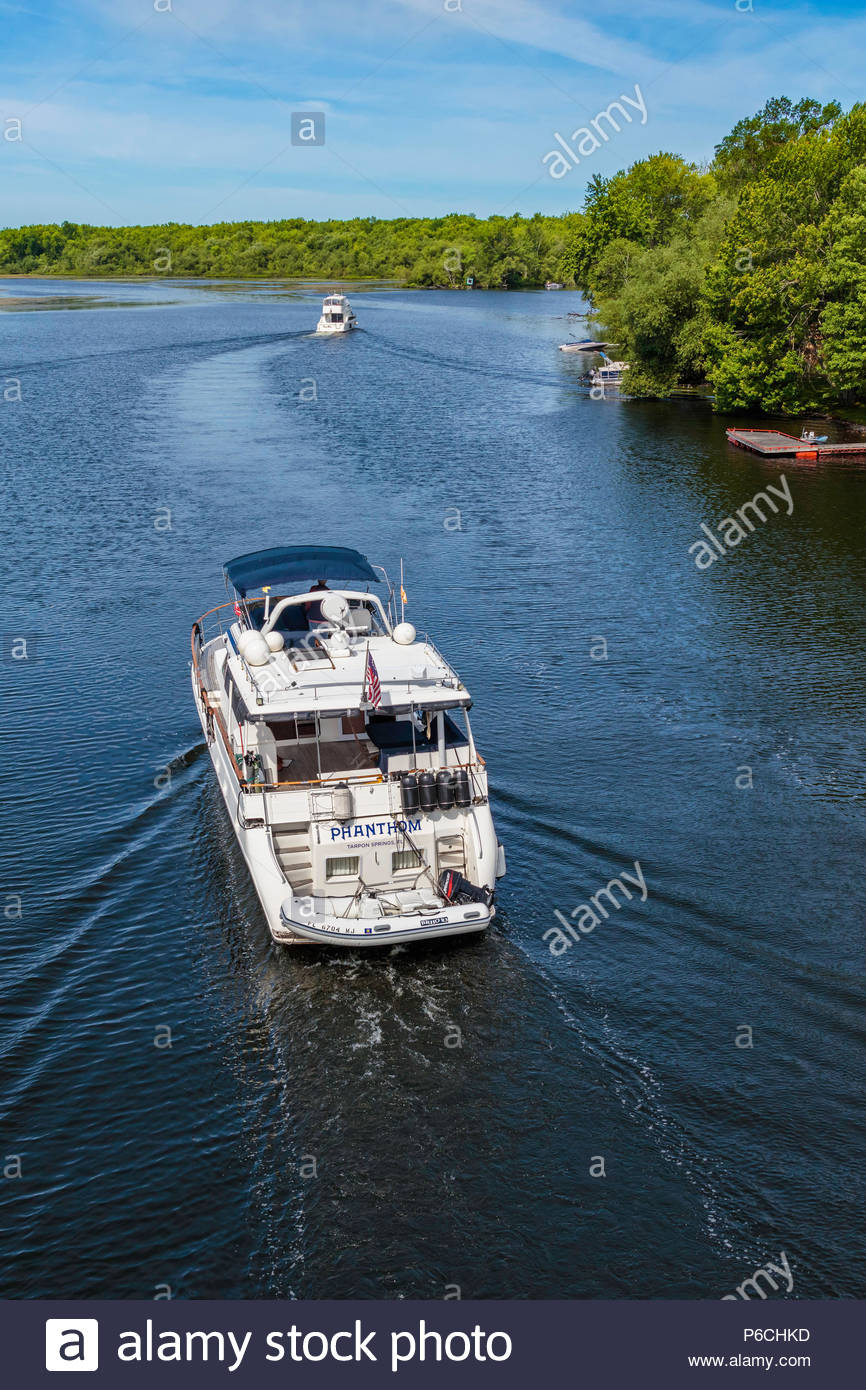 Pleasure boat cruising on the Otonabee River part of the Trent–Severn Waterway system in Peterborough County Ontario Canada - Stock Image