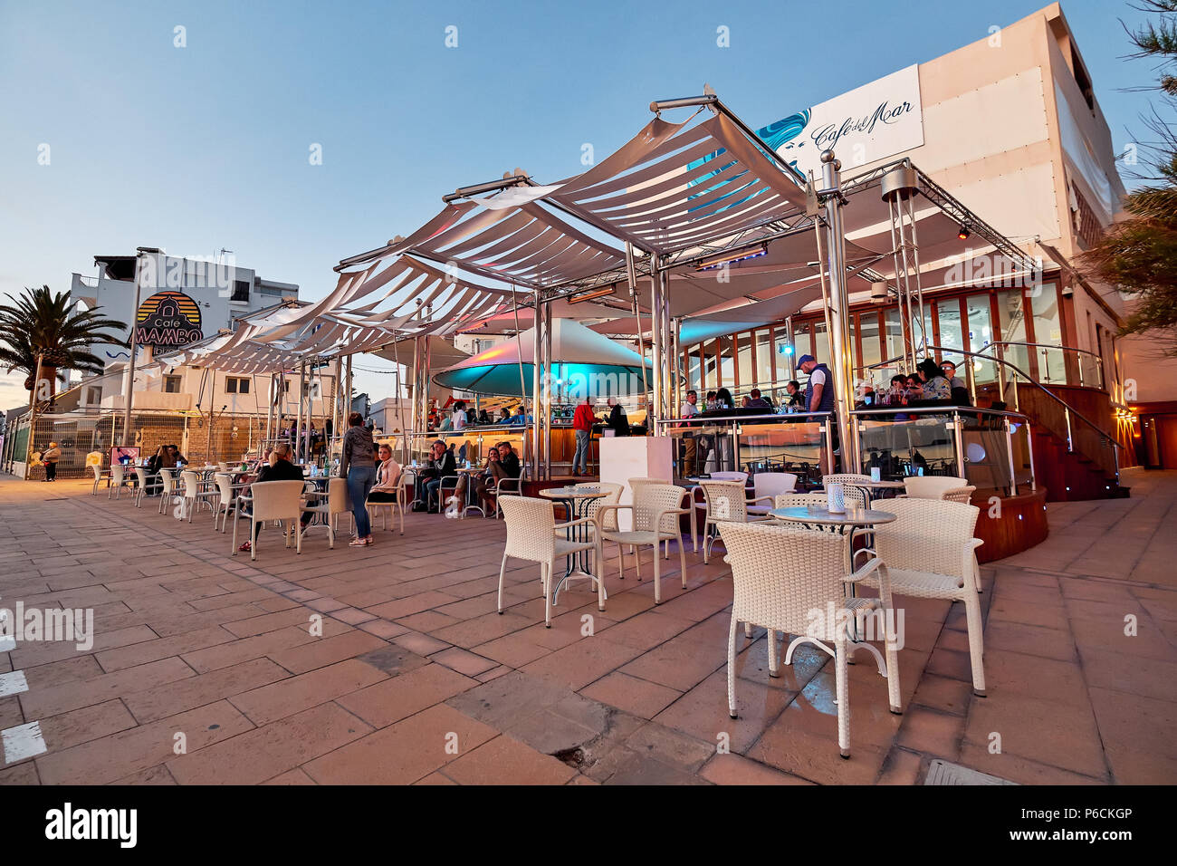 Ibiza Island, Spain - May 1, 2018: People at Cafe Del Mar cafe at sunset. This place is famous for views to the sunsets and lounge music. Ibiza, Balea - Stock Image