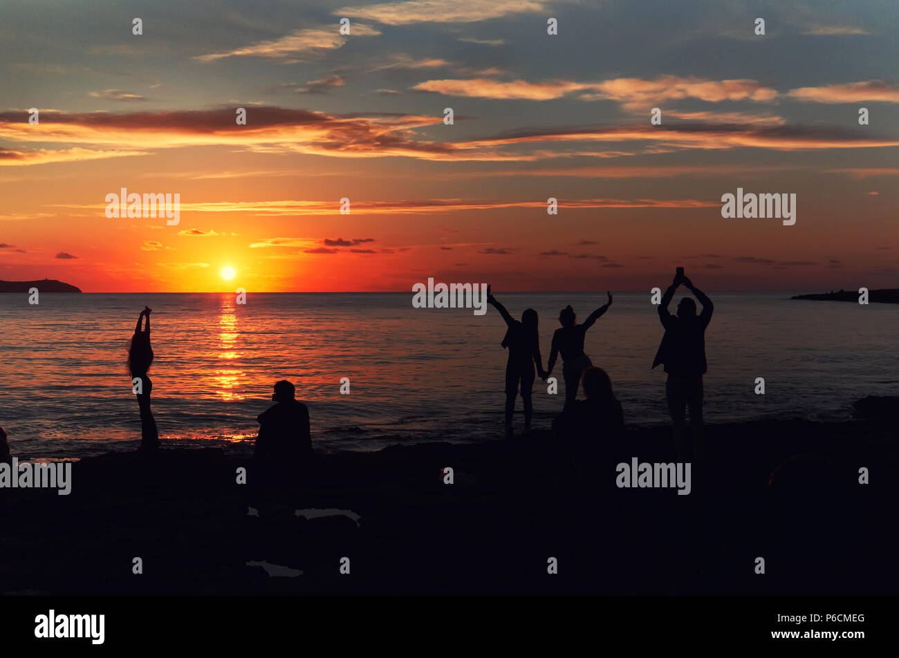 Silhouette of a people during the sunset at Cafe Del Mar. Ibiza Island. Balearic Islands. Spain - Stock Image
