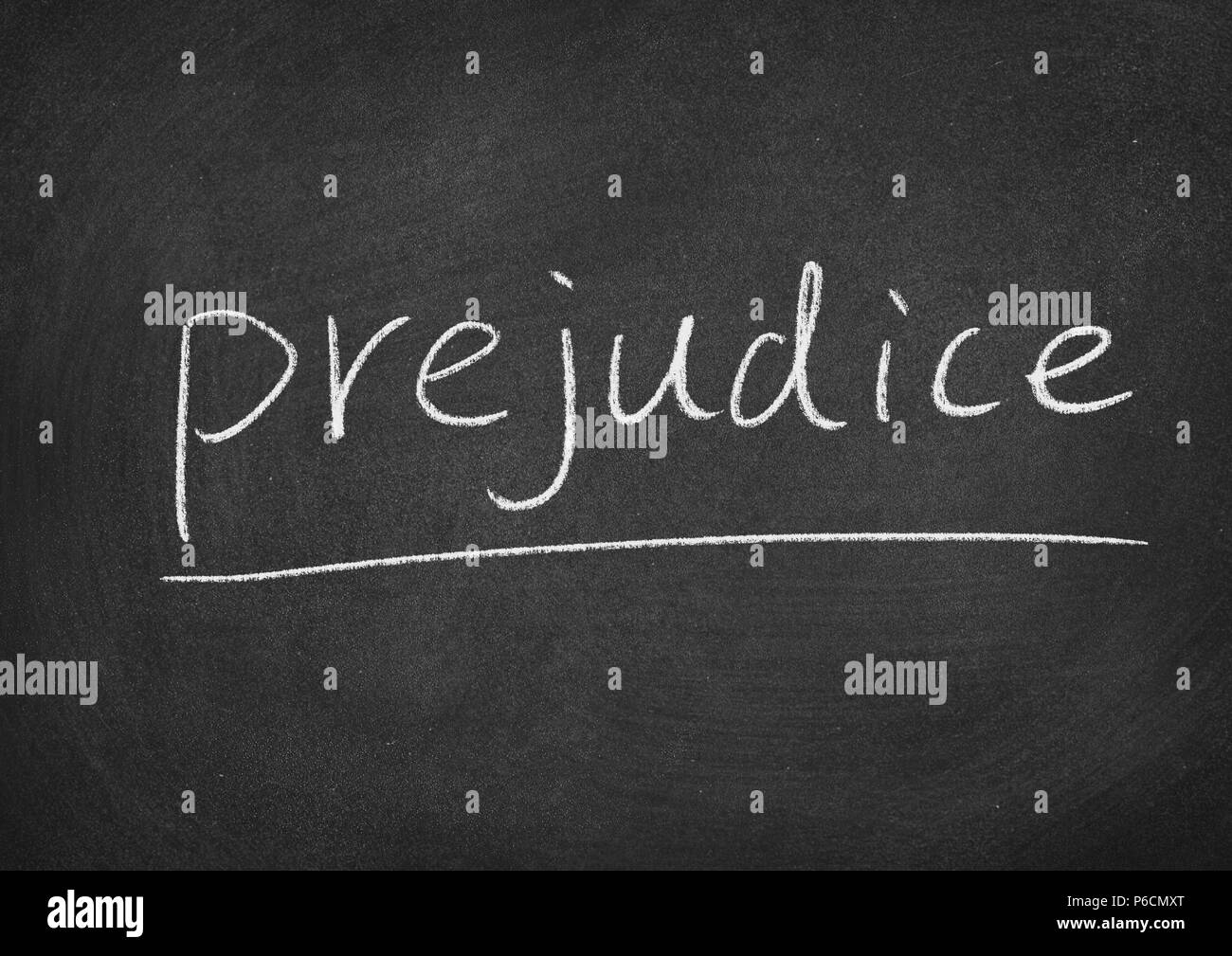 prejudice concept word on a blackboard background - Stock Image