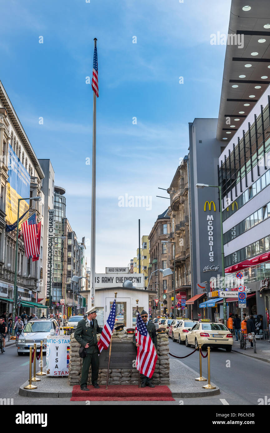 During the 'Cold War' Checkpoint Charlie used to be one of the most famous border crossings in the world. Nowadays it is a major tourist attraction in Stock Photo