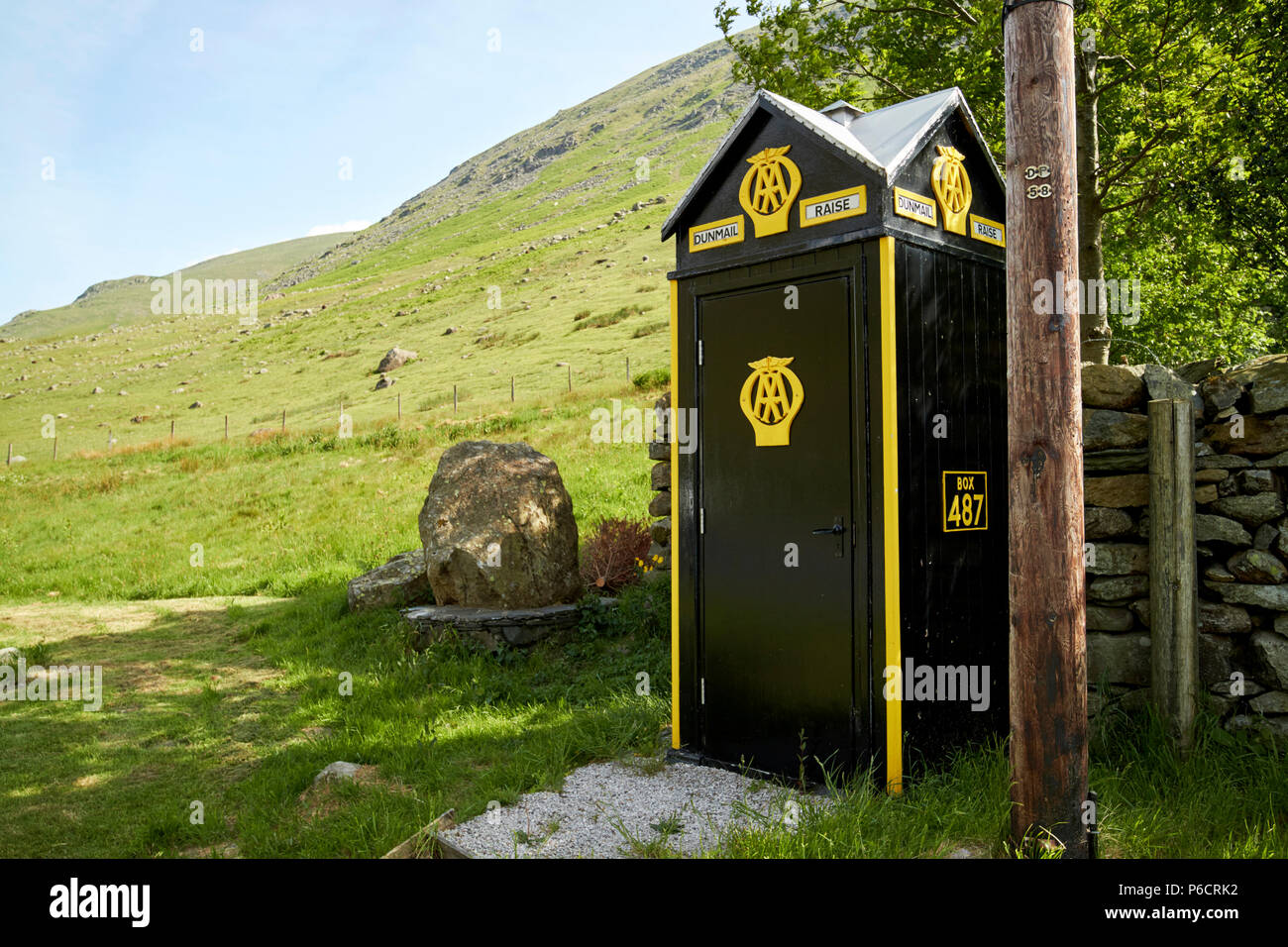 old aa telephone box with wooden telegraph pole on dunmail raise in the lake district cumbria england uk - Stock Image