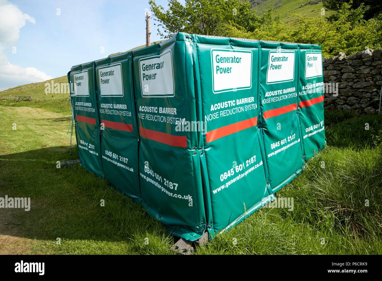 acoustic barrier noise reduction system around a temporary electricity generator in the lake district cumbria england uk - Stock Image