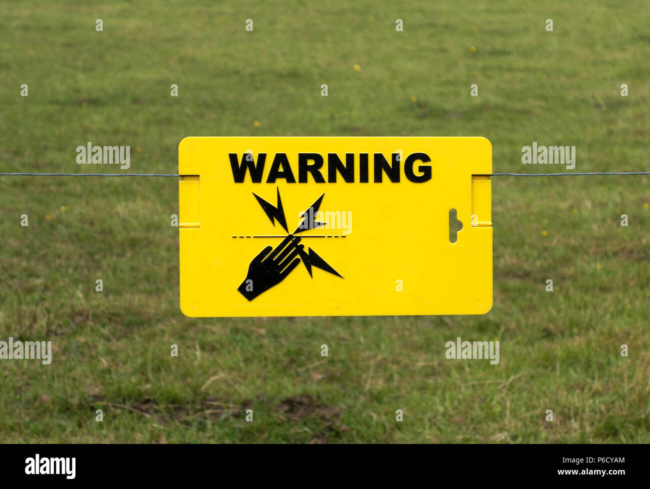 electric fence warning sign - Stock Image