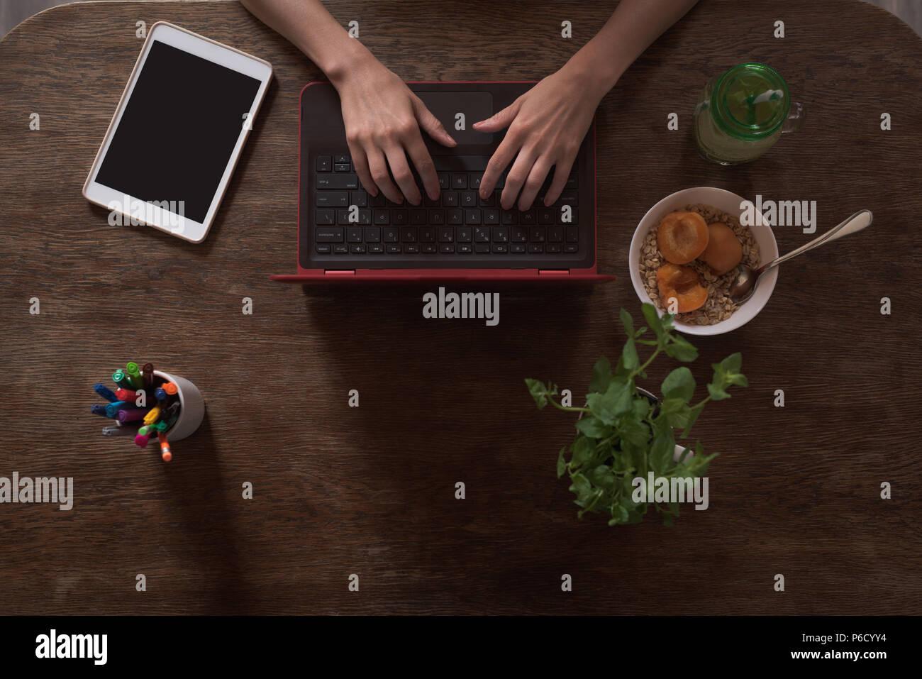 Female executive using laptop - Stock Image