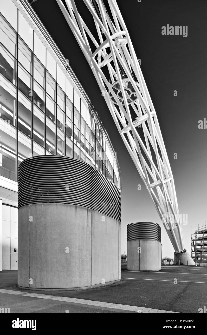 The Steel arch of Wembley stadium known as the 'Wembley arch' supports the roof structure is 134 meter (440 ft) high with a span of 317 metres (1,040  - Stock Image