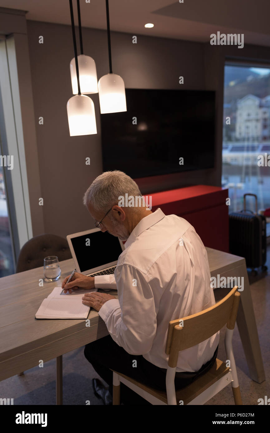 Businessman taking notes on a notebook Stock Photo