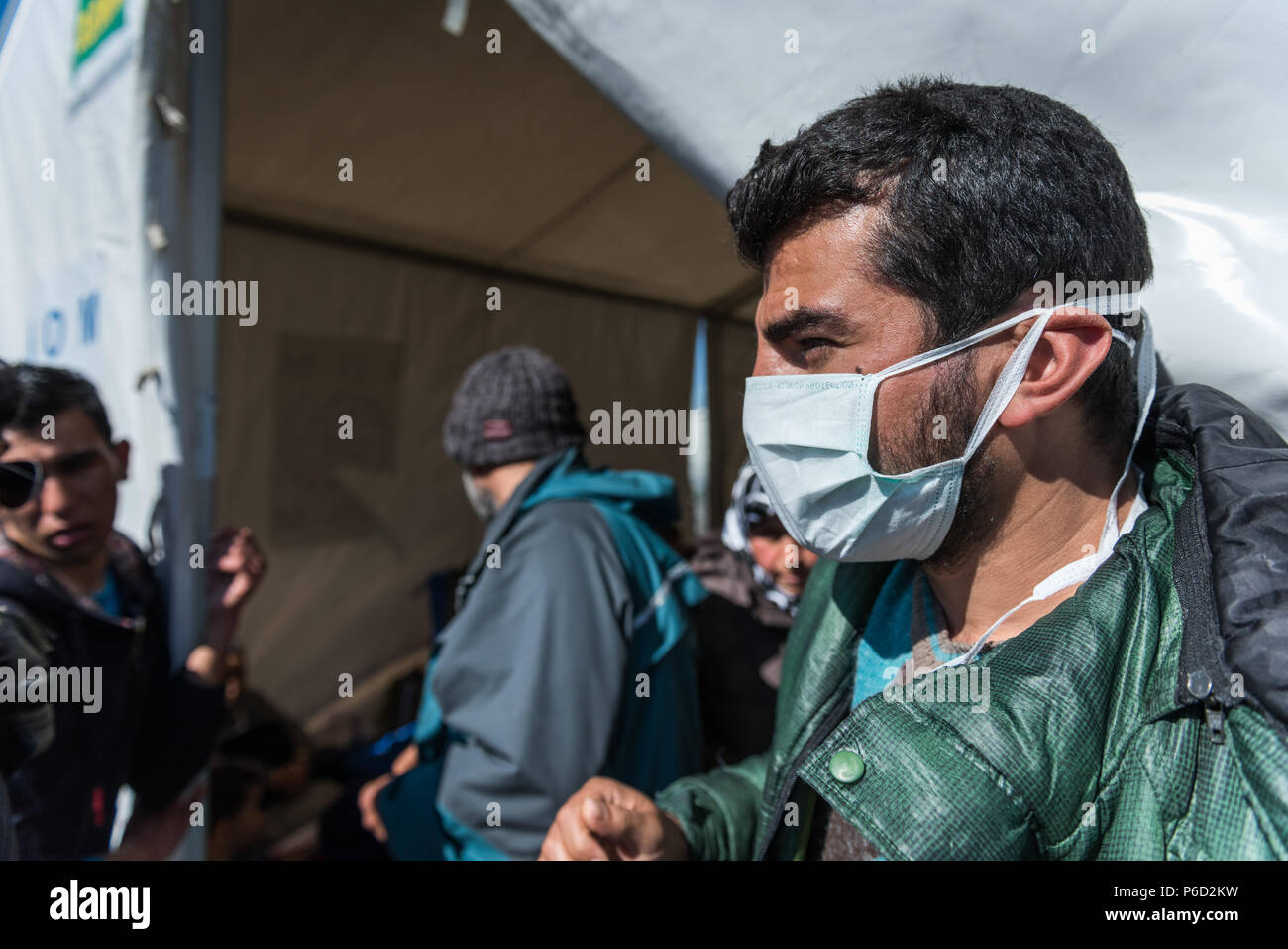 Unhygienic conditions in the refugee camp that prevail in the camp, some people wear masks at the makeshift refugee camp of the Greek-Macedonian borde Stock Photo