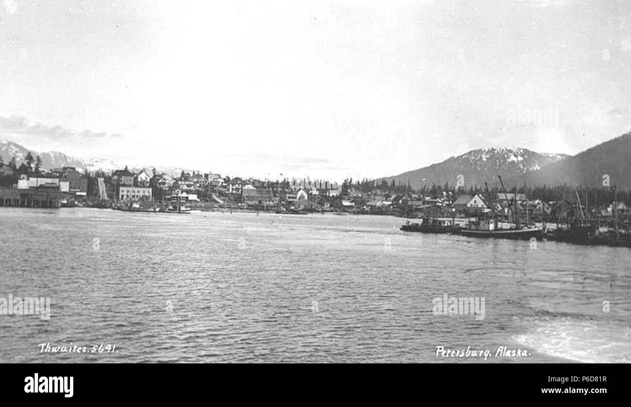 . English: View of Petersburg, ca. 1912 . English: Caption on image: Petersburg, Alaska PH Coll 247.811 Petersburg is located on the north end of Mitkof Island, where the Wrangell Narrows meet Frederick Sound. It lies midway between Juneau and Ketchikan, about 120 miles from either community. Tlingit Indians from Kake utilized the north end of Mitkof Island as a summer fish camp. Some reportedly began living year-round at the site, including John Lot. Petersburg was named after Peter Buschmann, a Norwegian immigrant and a pioneer in the cannery business, who arrived in the late 1890s. He built - Stock Image