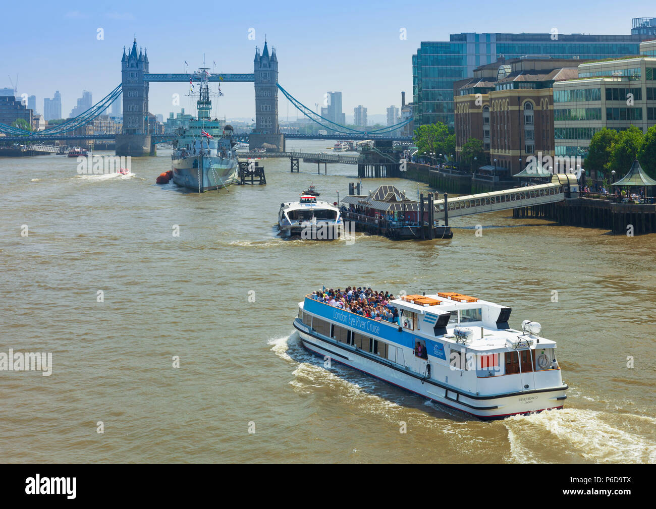 London eye river cruise boat on the river Thames approaching Tower bridge. - Stock Image