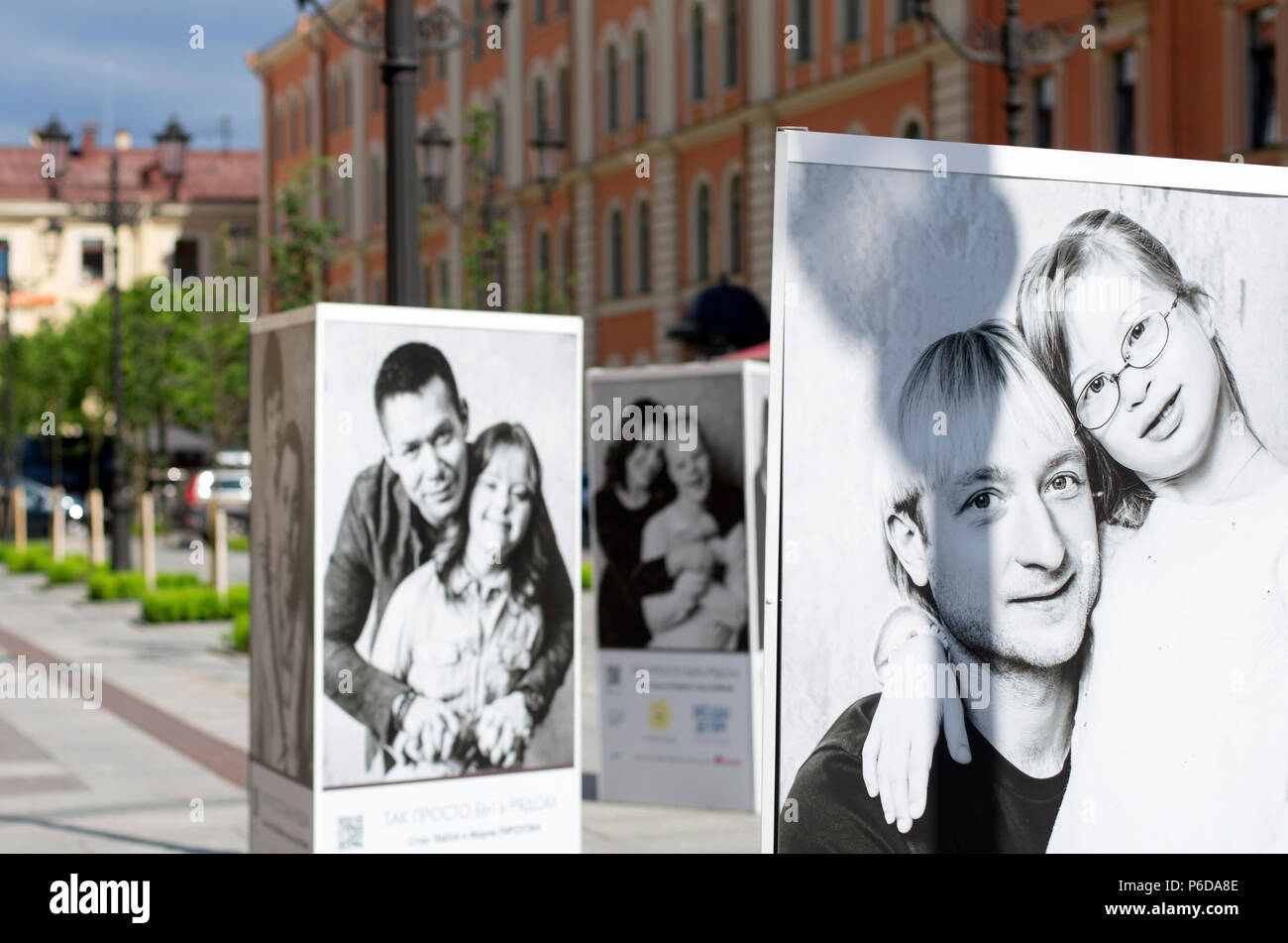 St. Petersburg, Russia - July 23, 2017: Posters with a charity project to help children with Down's syndrome, in which celebrities from Russia - Stock Image